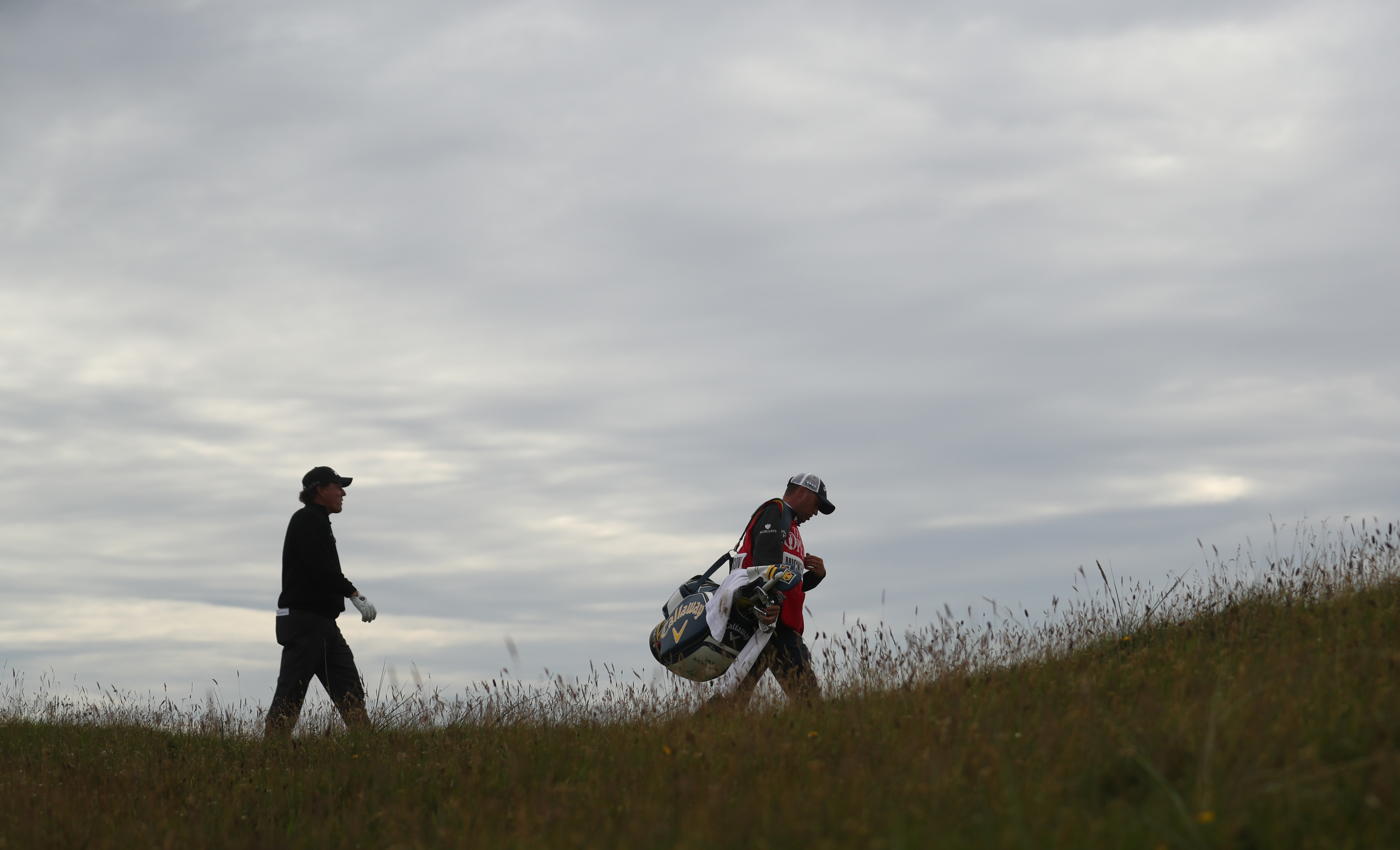 Phil Mickelson of the United States walks the 13th fairway during the final round of the British Open Golf Championship at the Royal Troon Golf Club in Troon, Scotland, Sunday, July 17, 2016. (AP Photo/Peter Morrison)