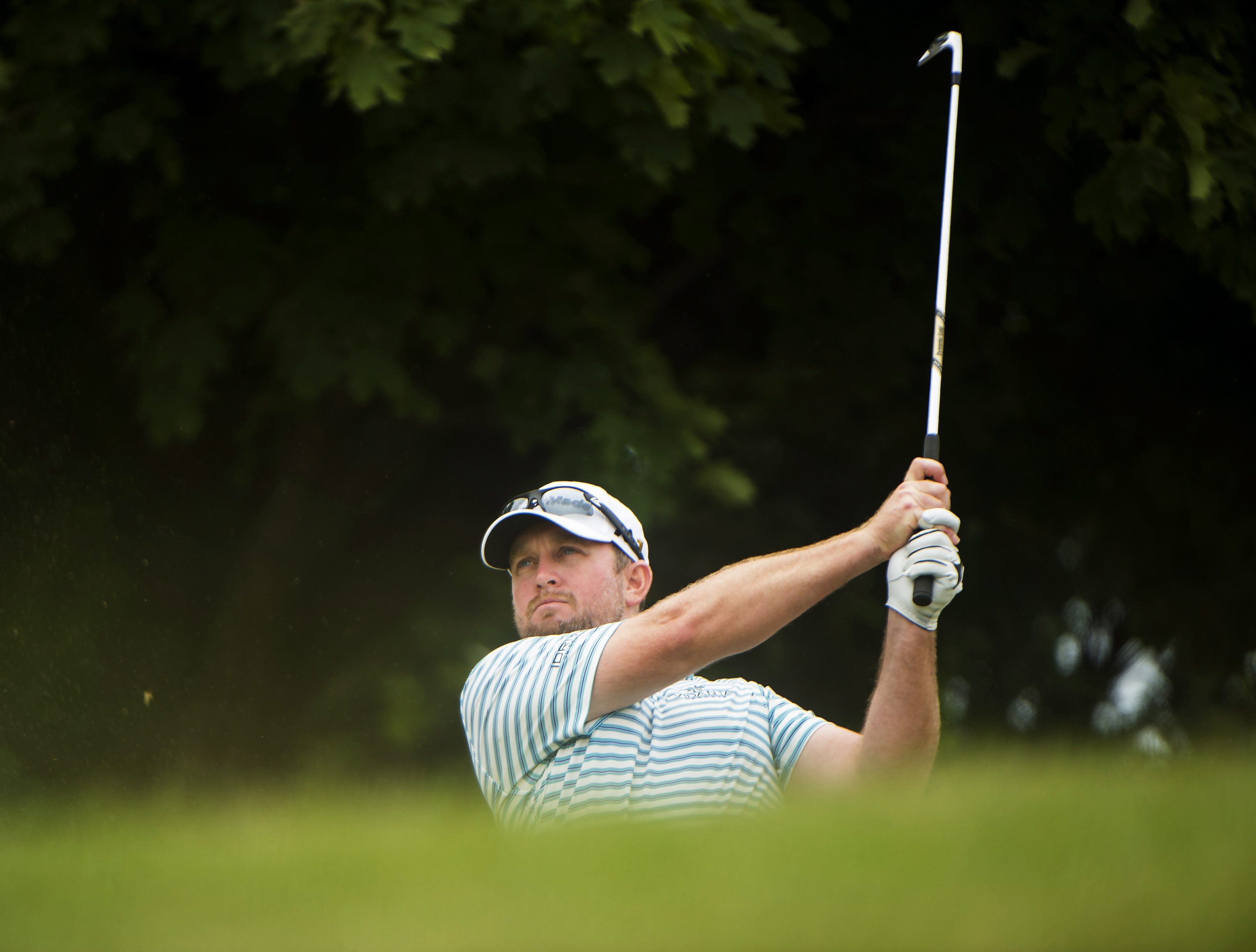 Steve Wheatcroft watches his tee shot on the seventh hole during the final round of the Canadian Open golf tournament, Sunday, July 24, 2016, in Oakville, Ontario. (Nathan Denette/The Canadian Press via AP)