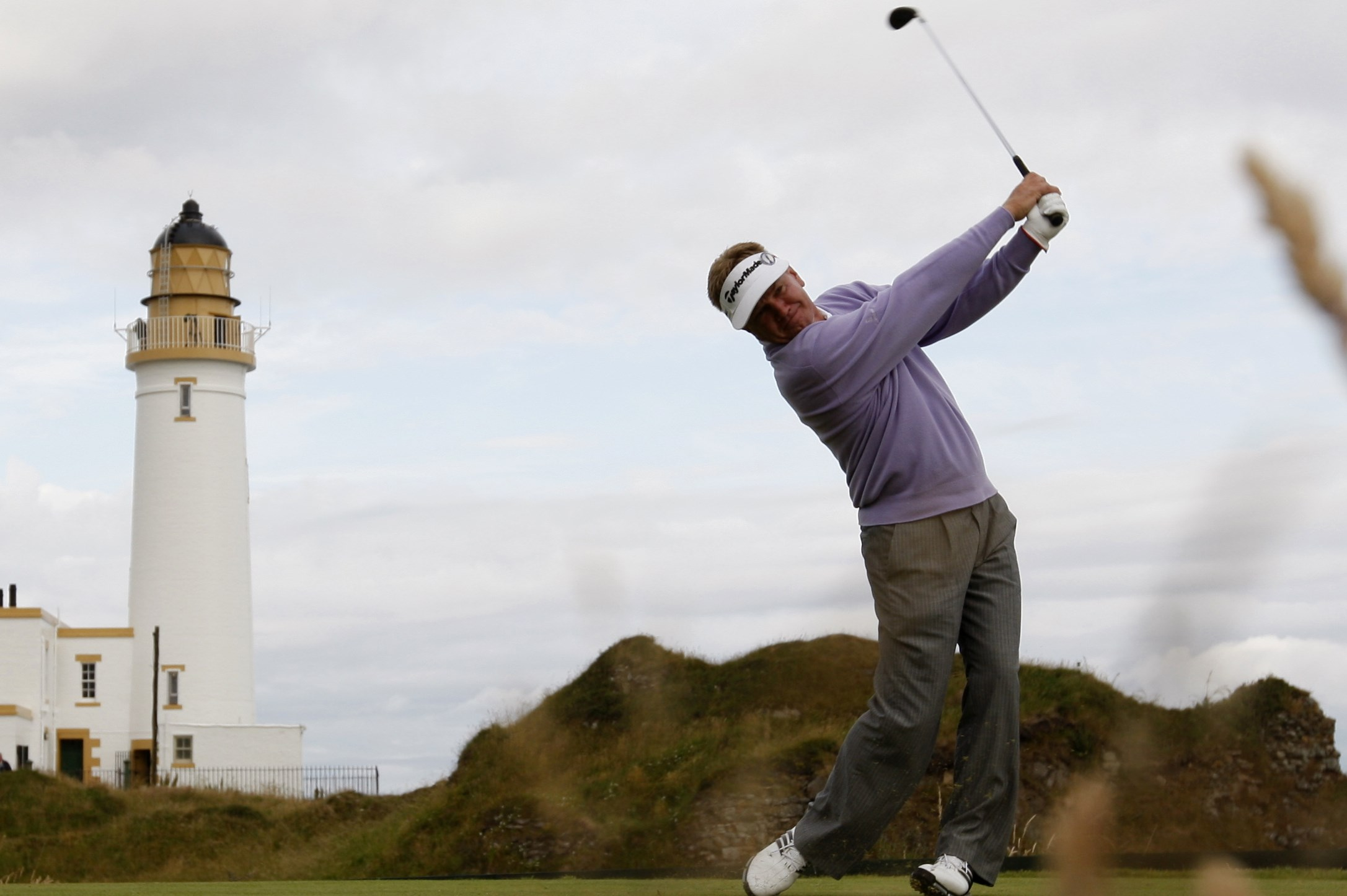 Paul Broadhurst of England plays from the tenth tee during the opening round of the British Open Golf championship, at the Turnberry golf course, Scotland, Thursday, July 16, 2009. (AP Photo/Jon Super)
