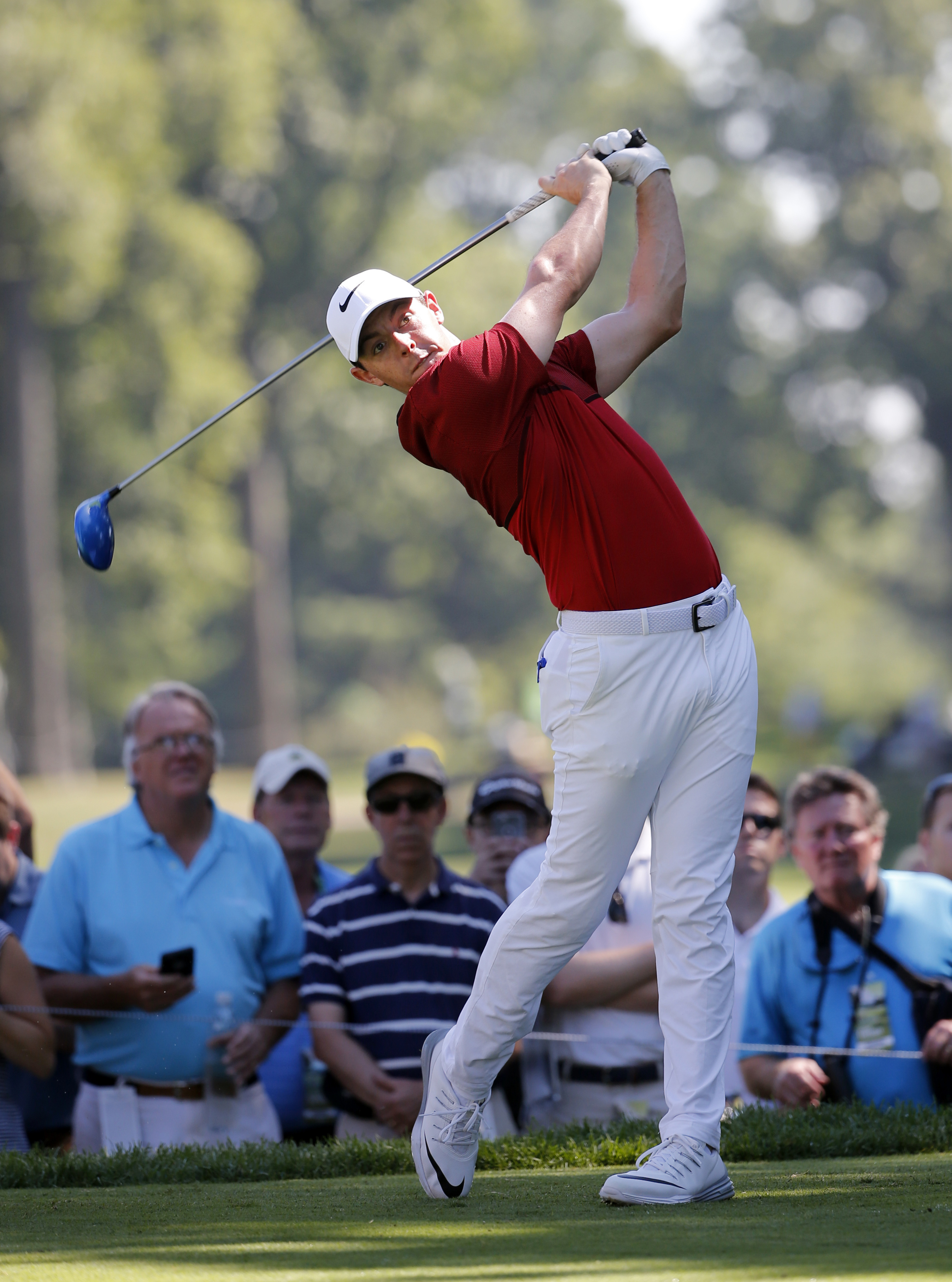 Rory McIlroy watches his tee shot on the sixth hole during a practice round for the PGA Championship golf tournament at Baltusrol Golf Club in Springfield, N.J., Tuesday, July 26, 2016. (AP Photo/Mike Groll)