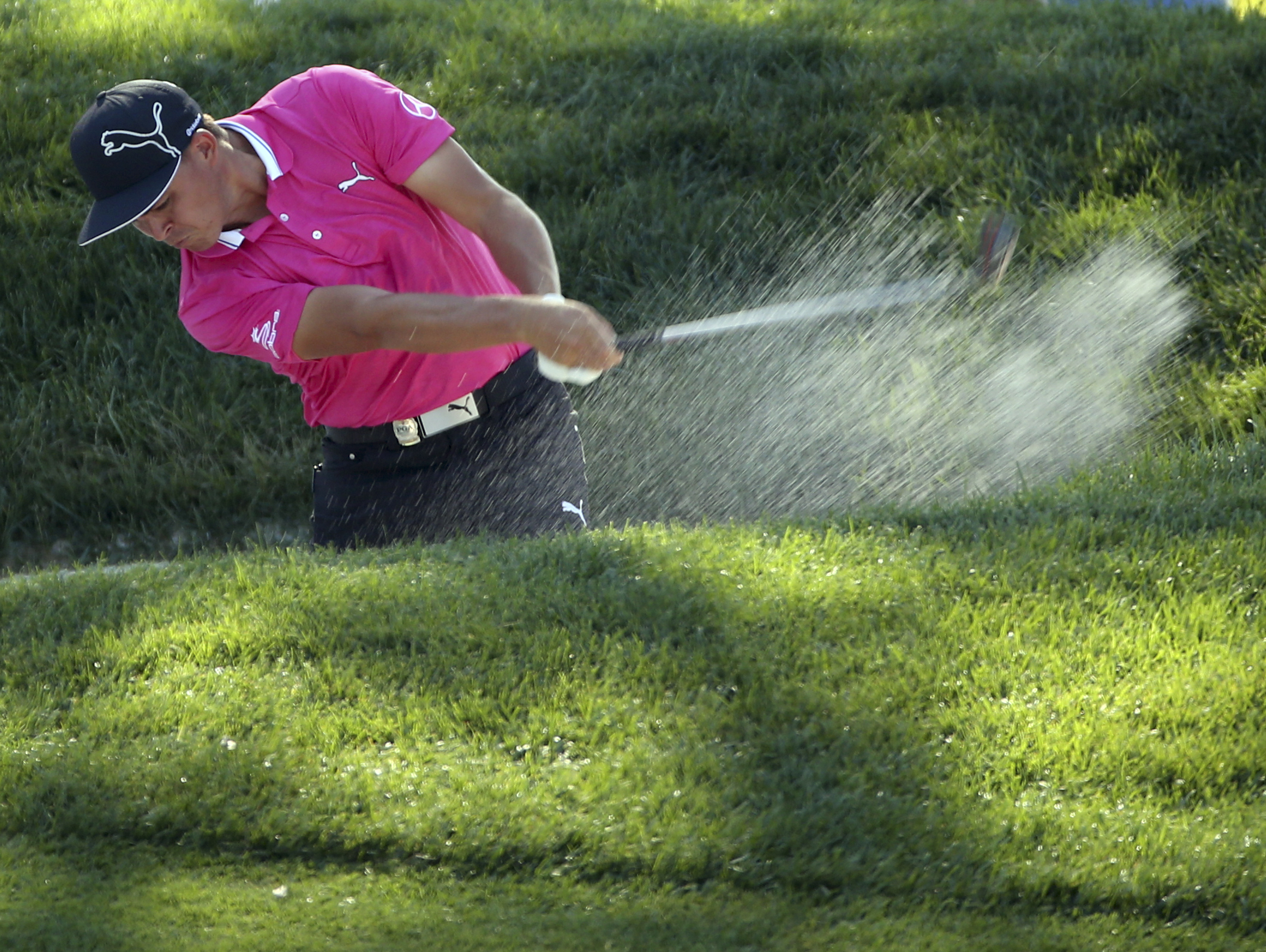 Rickie Fowler hits from a sand trap on the 15th hole during a practice round for the PGA Championship golf tournament at Baltusrol Golf Club in Springfield, N.J., Wednesday, July 27, 2016. (AP Photo/Seth Wenig)