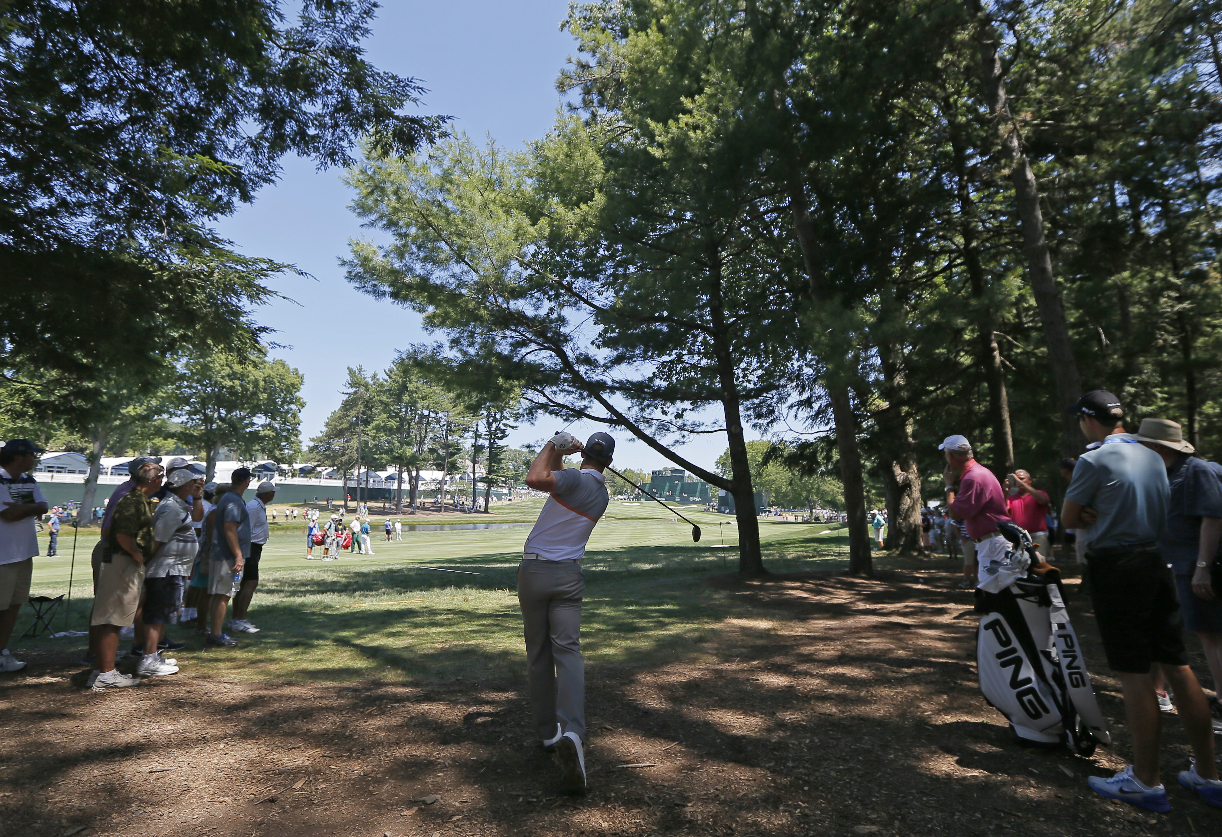 Brandon Stone, of South Africa, hits from the rough on the 18th hole during a practice round for the PGA Championship golf tournament at Baltusrol Golf Club in Springfield, N.J., Wednesday, July 27, 2016. (AP Photo/Tony Gutierrez)