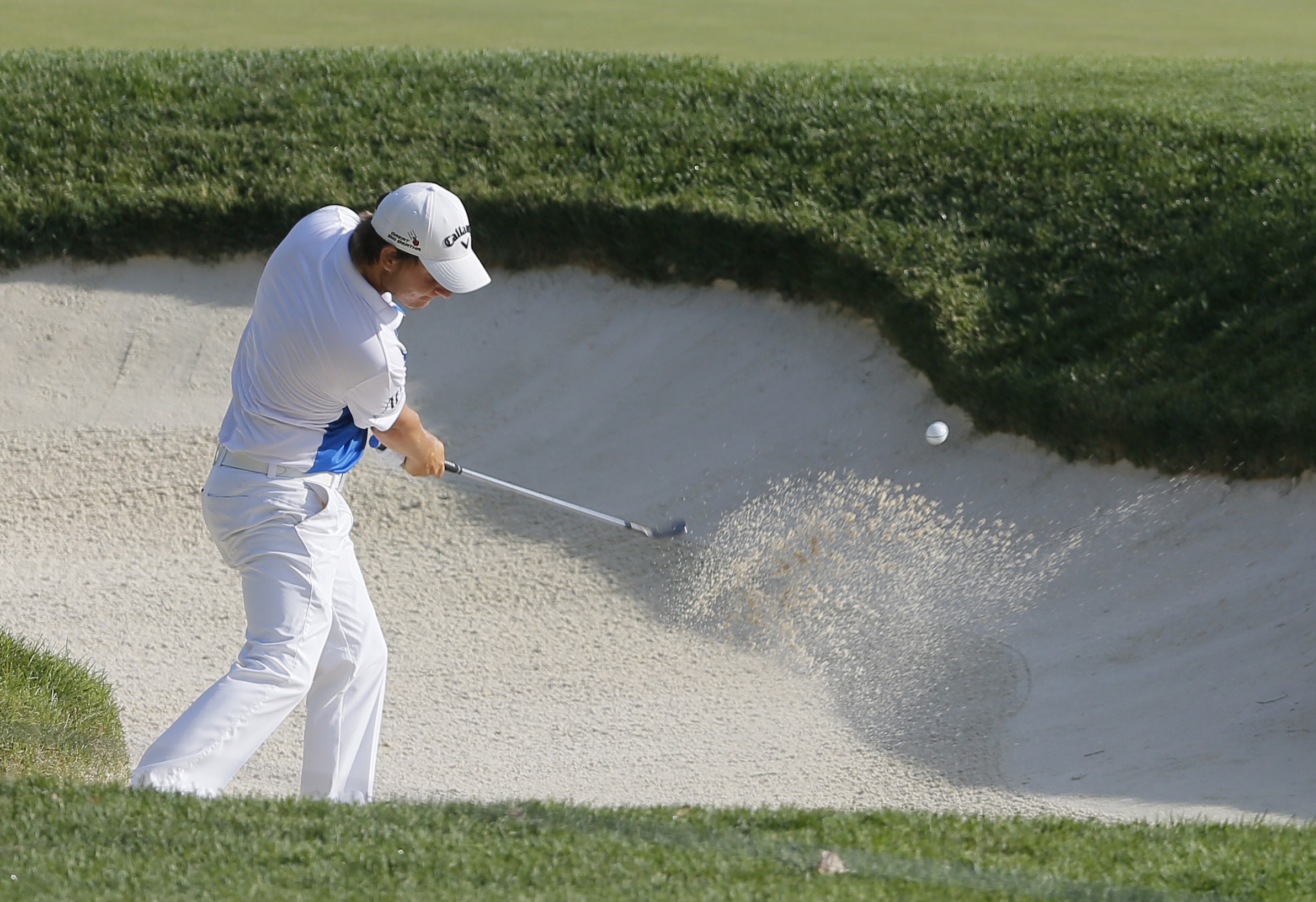 Emiliano Grillo, of Argentina, hits from a sand trap on the third hole during the first round of the PGA Championship golf tournament at Baltusrol Golf Club in Springfield, N.J., Thursday, July 28, 2016. (AP Photo/Tony Gutierrez)