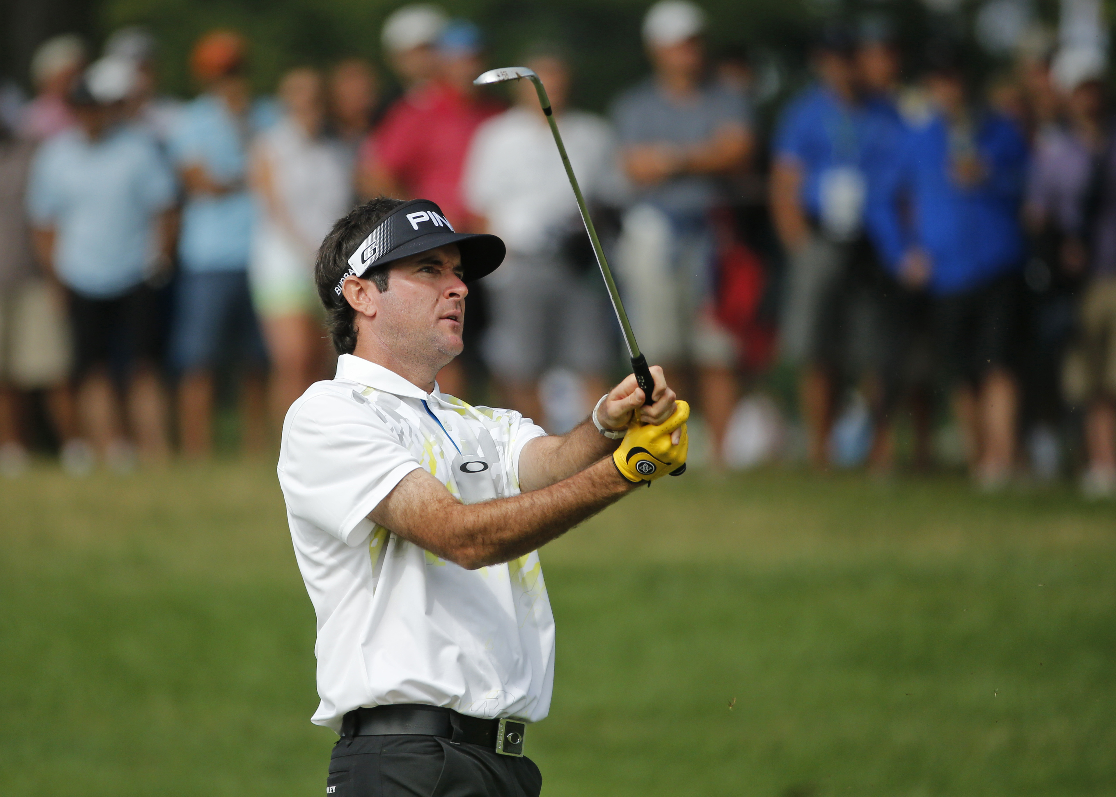 Bubba Watson watches his approach shot on the 14th hole during the second round of the PGA Championship golf tournament at Baltusrol Golf Club in Springfield, N.J., Friday, July 29, 2016. (AP Photo/Mike Groll)