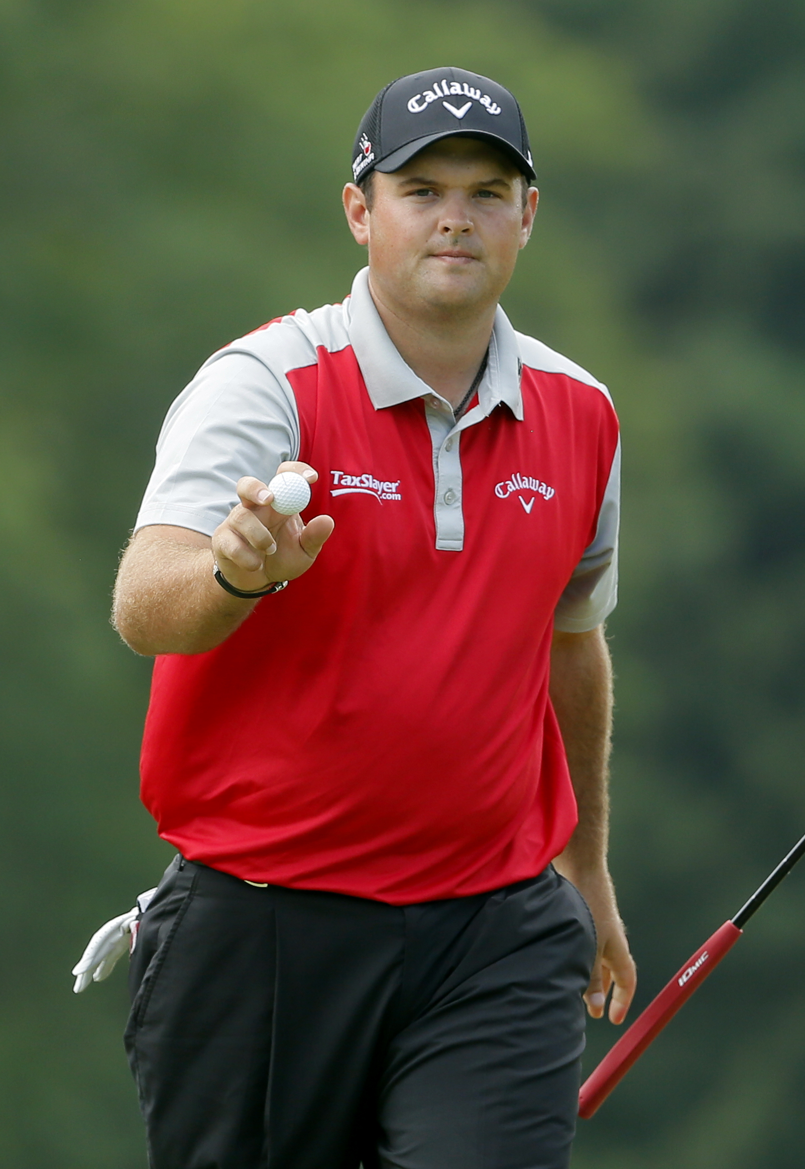 Patrick Reed waves to the crowd after making a putt on the 18th hole during the second round of the PGA Championship golf tournament at Baltusrol Golf Club in Springfield, N.J., Friday, July 29, 2016. (AP Photo/Tony Gutierrez)