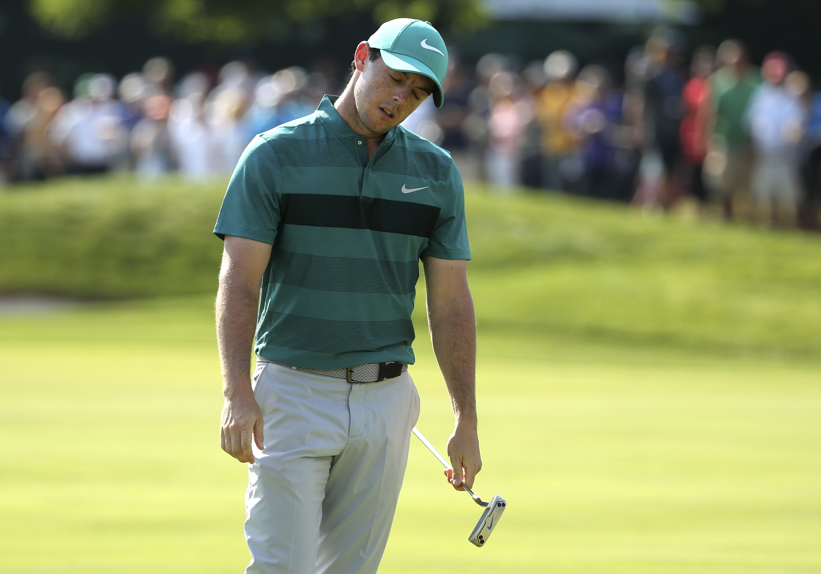 Rory McIlroy react to missing a putt on the 10th hole during the second round of the PGA Championship golf tournament at Baltusrol Golf Club in Springfield, N.J., Friday, July 29, 2016. (AP Photo/Seth Wenig)
