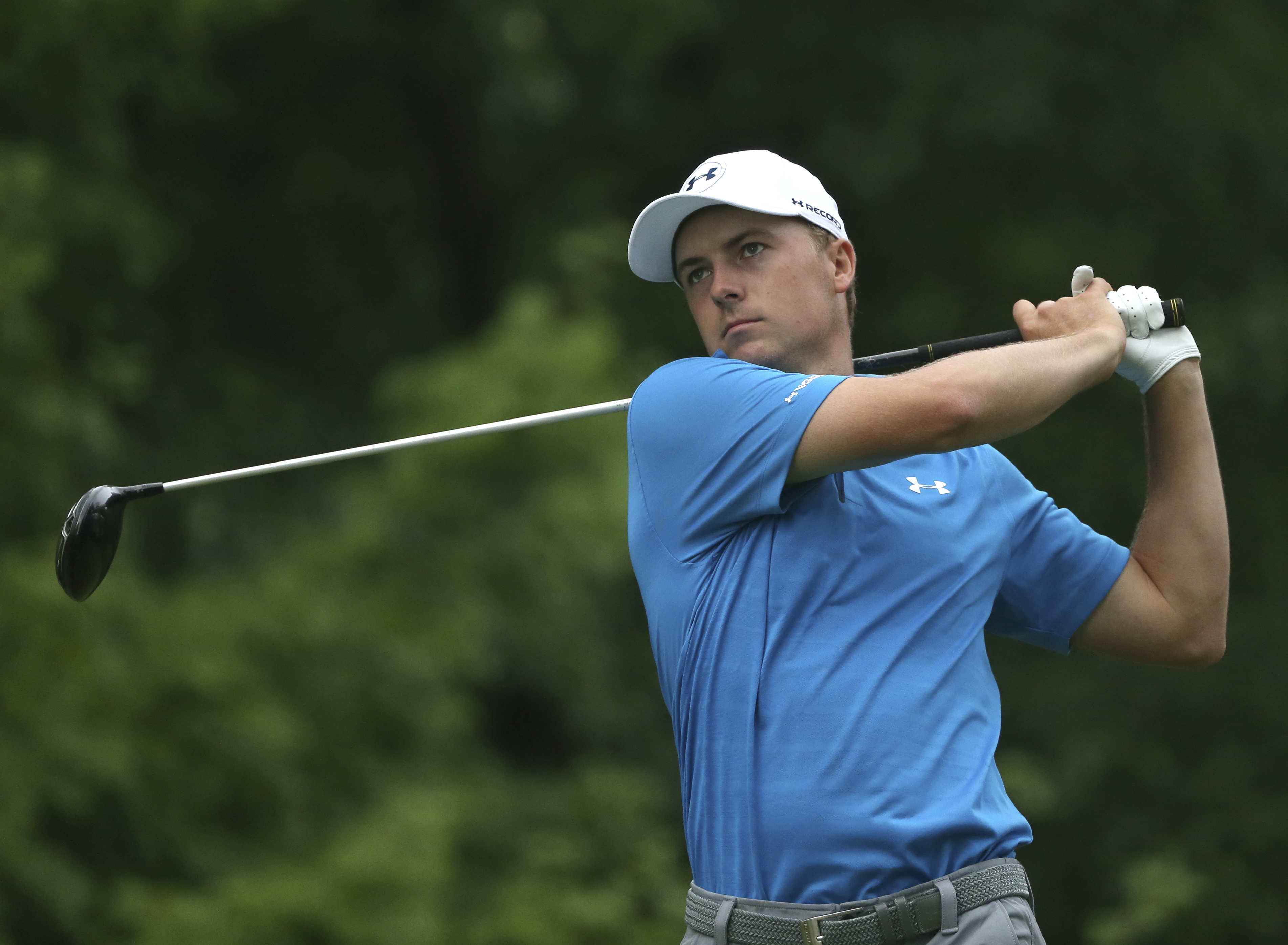 Jordan Spieth watches his tee shot on the third hole during the third round of the PGA Championship golf tournament at Baltusrol Golf Club in Springfield, N.J., Sunday, July 31, 2016. (AP Photo/Seth Wenig)