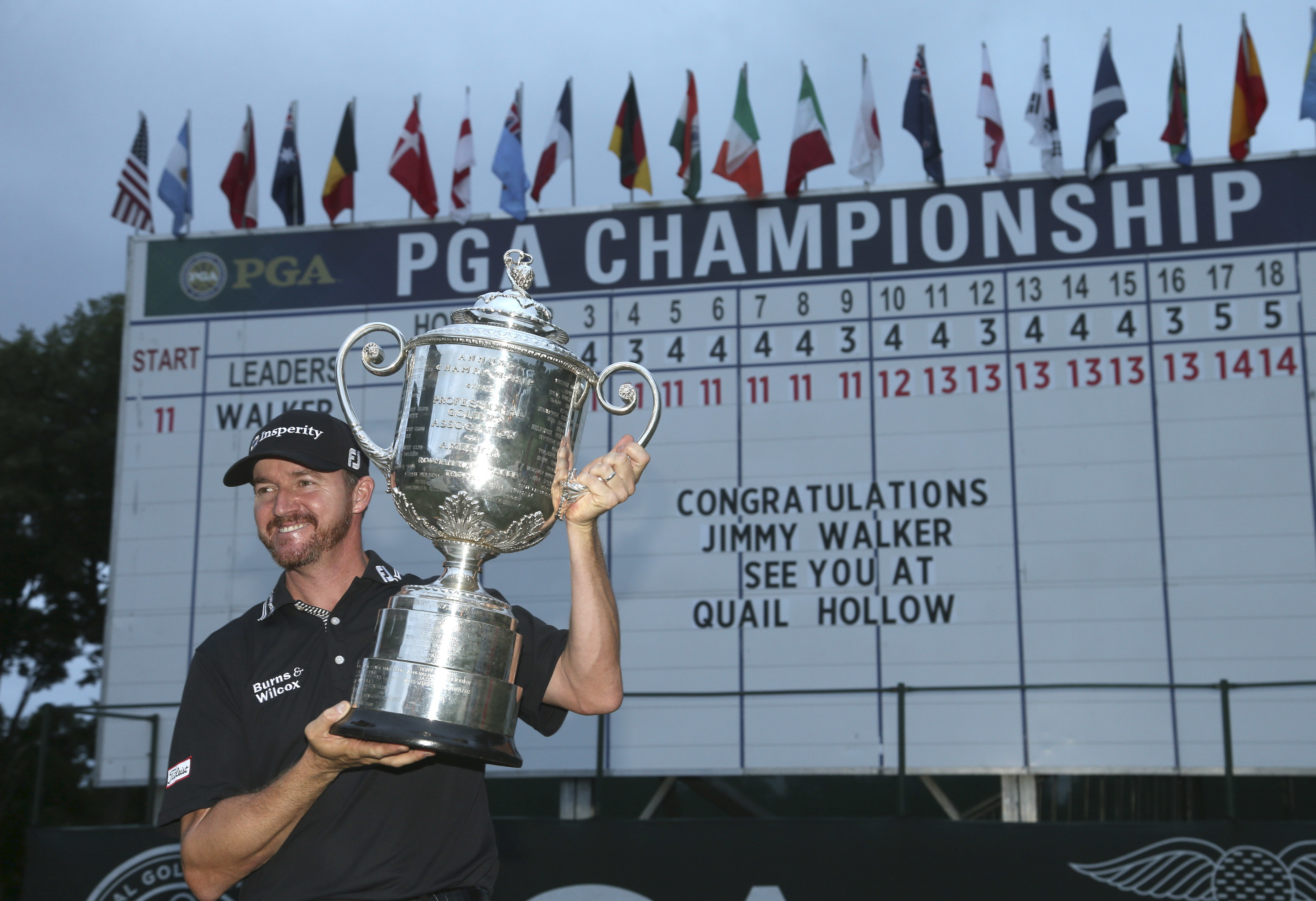 Jimmy Walker poses with the trophy after winning the PGA Championship golf tournament at Baltusrol Golf Club in Springfield, N.J., Sunday, July 31, 2016. (AP Photo/Seth Wenig)
