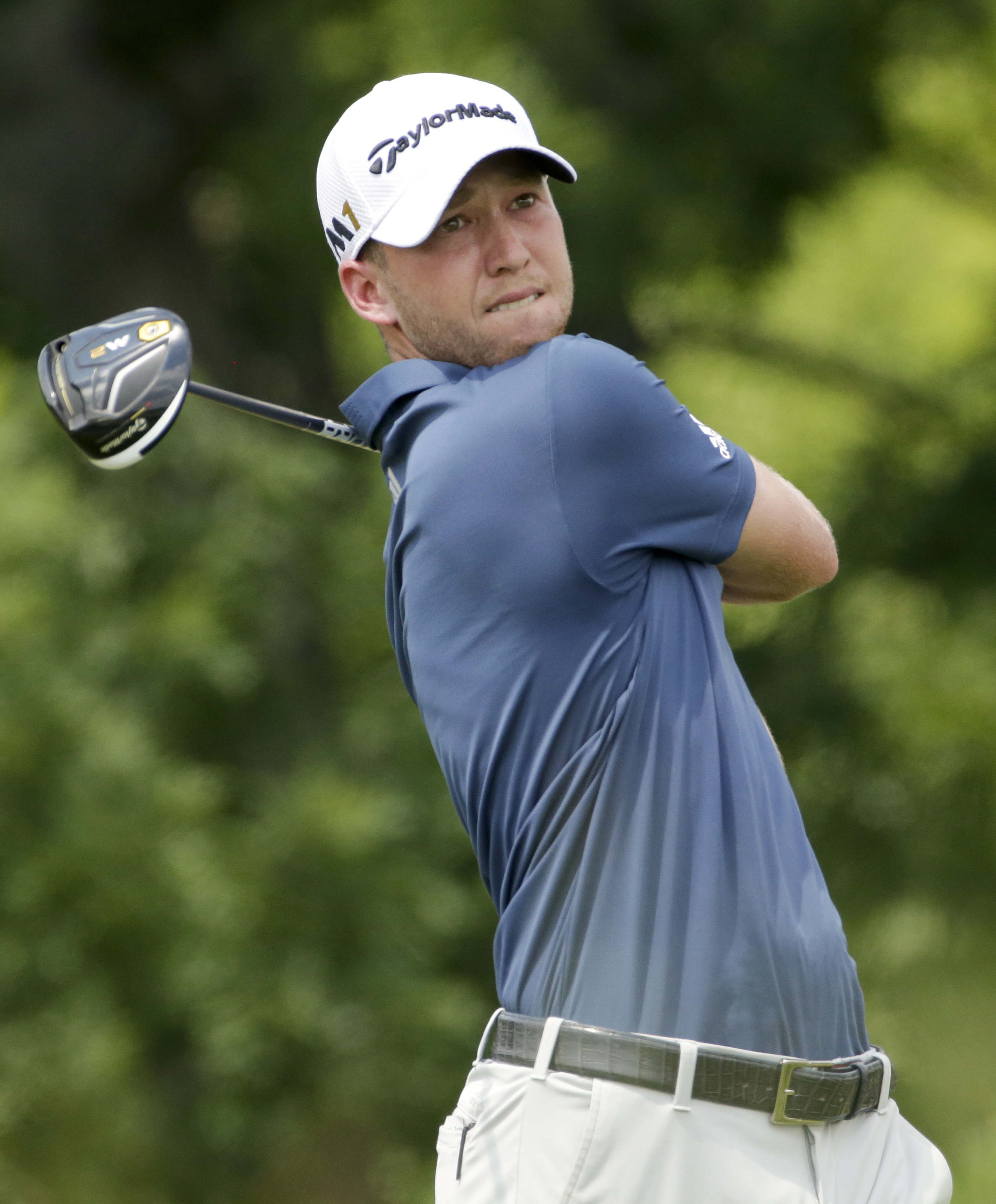 Daniel Berger watches his tee shot on the fourth hole during the final round of the U.S. Open golf championship at Oakmont Country Club on Sunday, June 19, 2016, in Oakmont, Pa. (AP Photo/Gene J. Puskar)