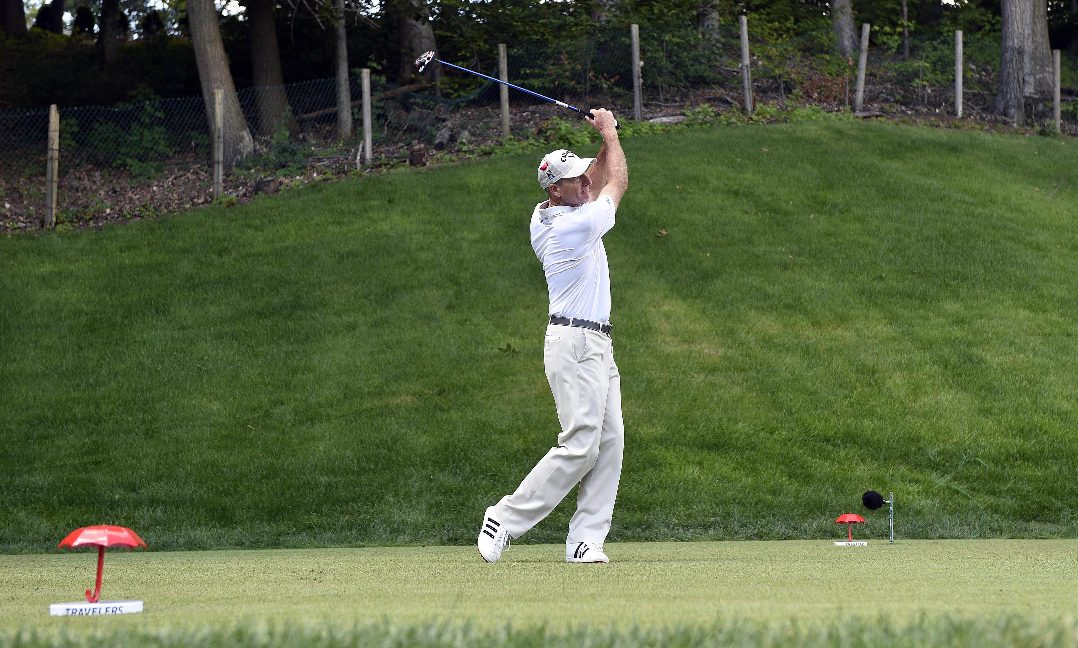 FILE - In this Aug. 7, 2016 photo, Jim Furyk tees off on the 15th hole during the final round of the Travelers Championship golf tournament in Cromwell, Conn. PGA Tour commissioner Tim Finchem said the PGA would build a 32,000-square foot clubhouse at the