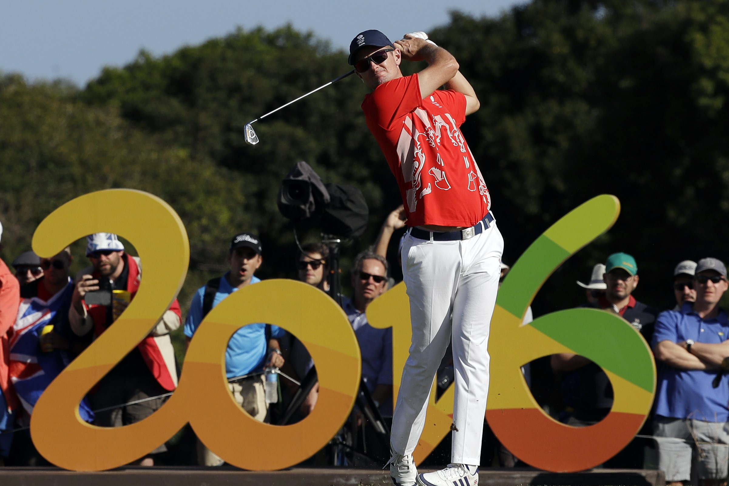 Justin Rose of Great Britain, tees off on the 16th hole during the third round of the men's golf event at the 2016 Summer Olympics in Rio de Janeiro, Brazil, Saturday, Aug. 13, 2016. (AP Photo/Alastair Grant)