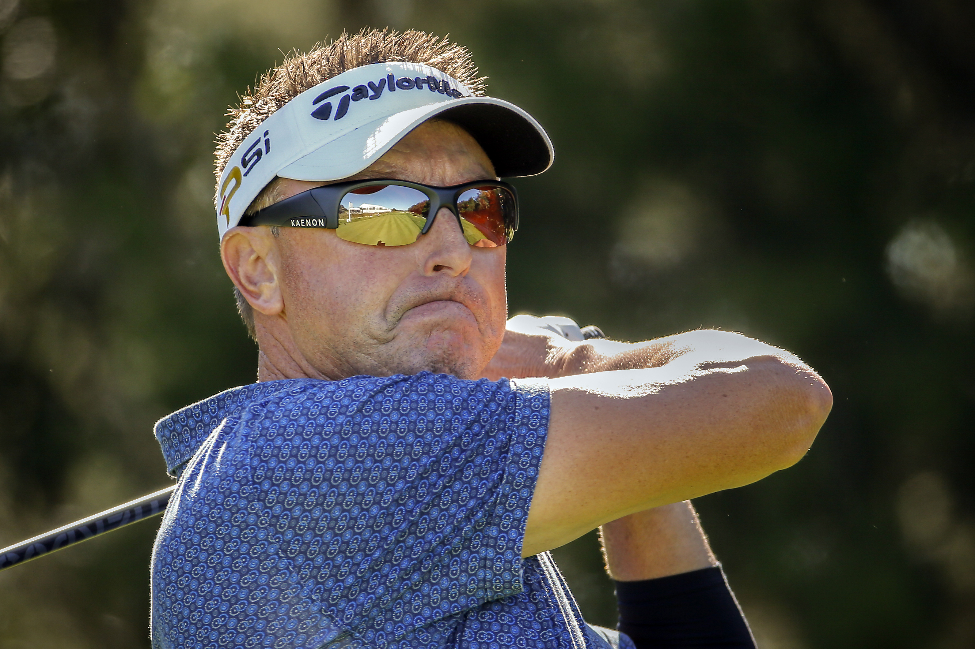Robert Allenby, of Australia, reacts to his shot off the 10th tee on the Seaside Course at the Sea Island Golf Club during the second round at the RSM Classic golf tournament, Friday, Nov 20, 2015, in St. Simons Island, Ga. (AP Photo/Stephen B. Morton)