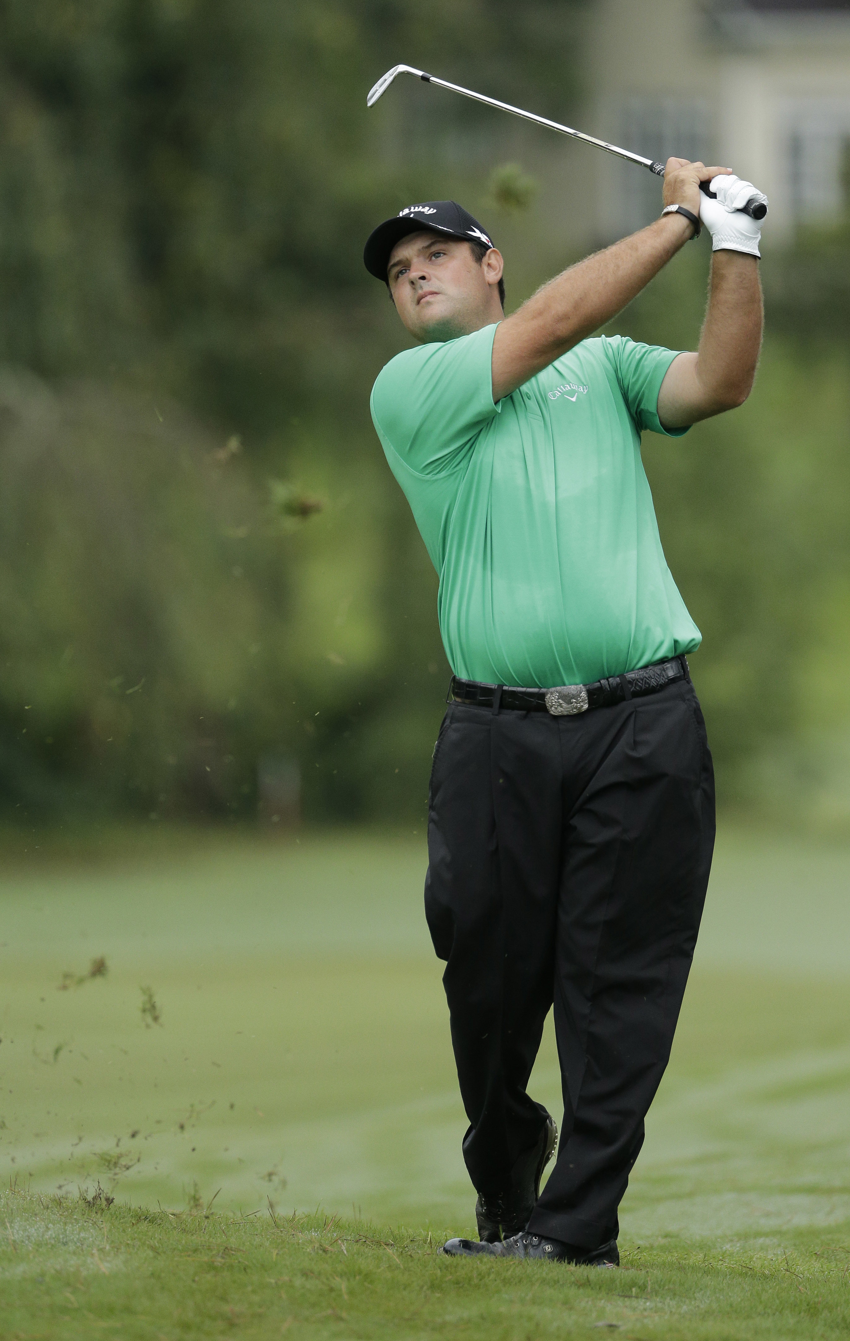Patrick Reed watches his approach shot to the 10th hole during the first round of the Wyndham Championship golf tournament in Greensboro, N.C., Thursday, Aug. 18, 2016. (AP Photo/Chuck Burton)