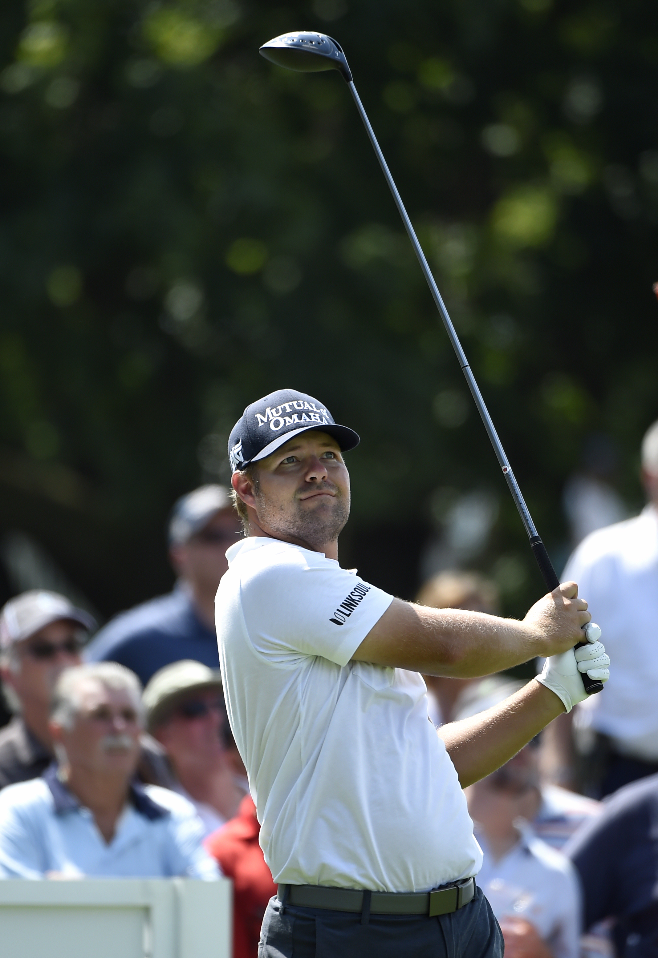 Ryan Moore watches his tee shot from the 15th hole during the second round of The Barclays golf tournament in Farmingdale, N.Y., Friday, Aug. 26, 2016, (AP Photo/Kathy Kmonicek)