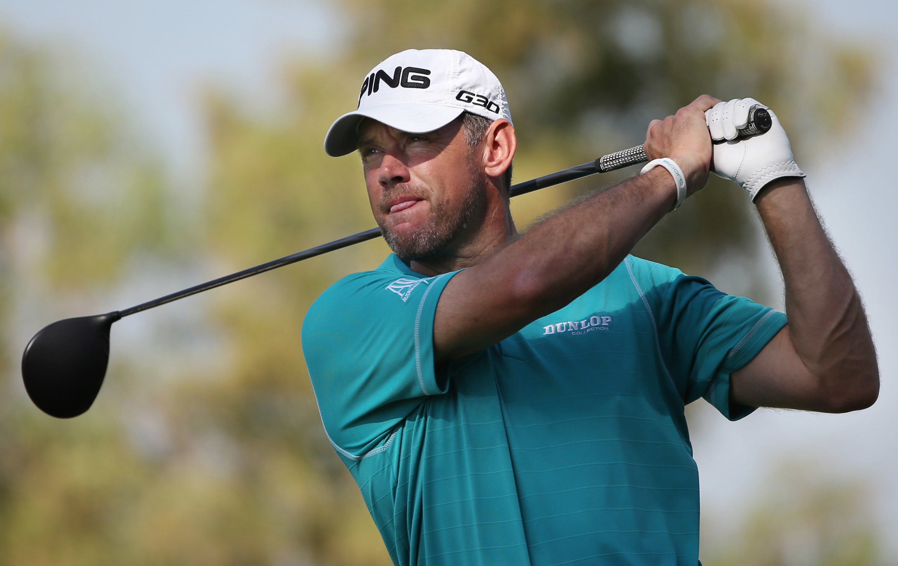FILE - In this Nov. 19, 2015, file photo, Lee Westwood of England tees off on the second hole during the round one of DP World Tour Championship golf tournament in Dubai, United Arab Emirates. Lee Westwood, Martin Kaymer and Thomas Pieters will fill out t