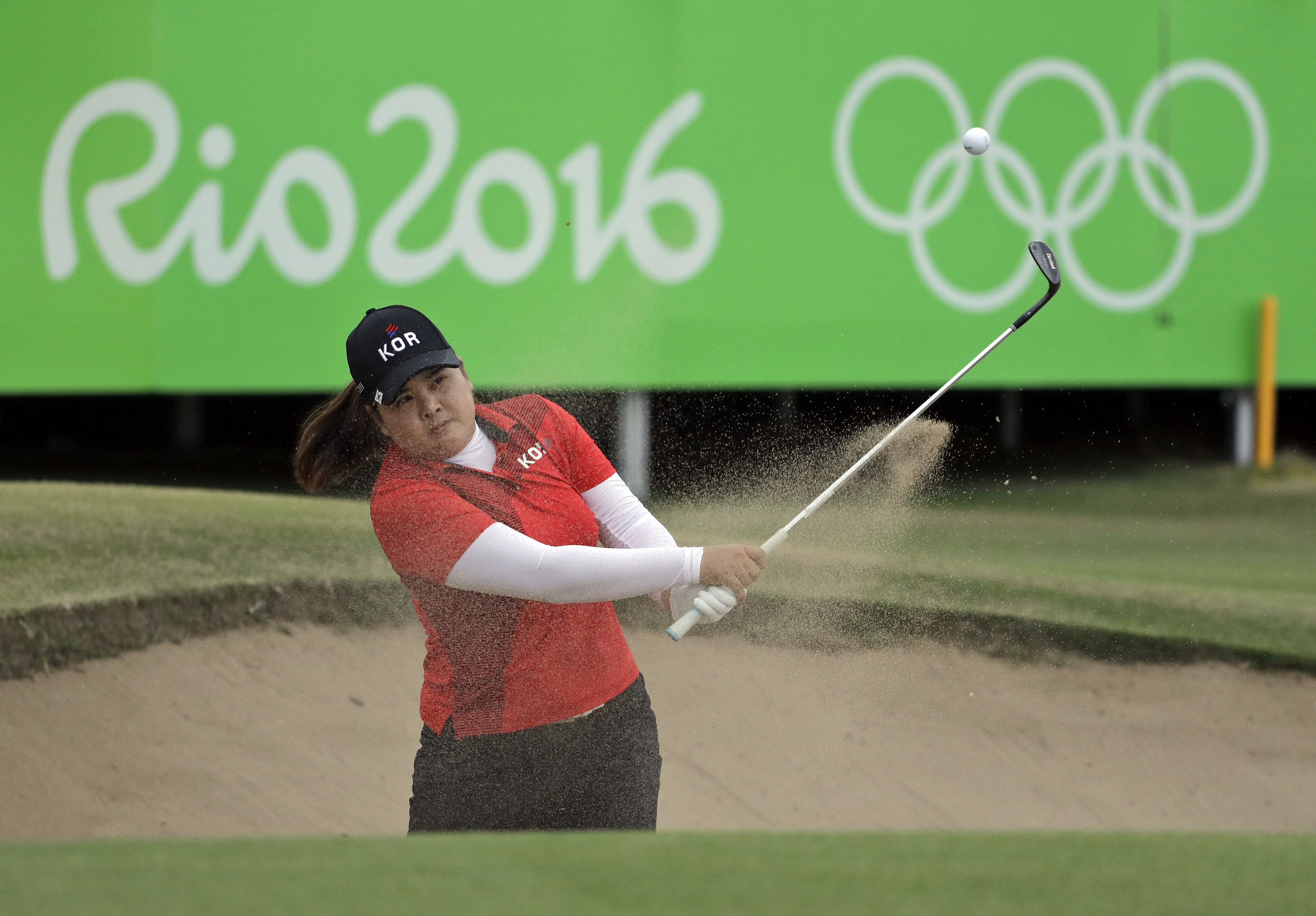 Inbee Park of South Korea, hits from the bunker on the 18th hole during the final round of the women's golf event at the 2016 Summer Olympics in Rio de Janeiro, Brazil, Saturday, Aug. 20, 2016. Park won the gold medal. (AP Photo/Chris Carlson)