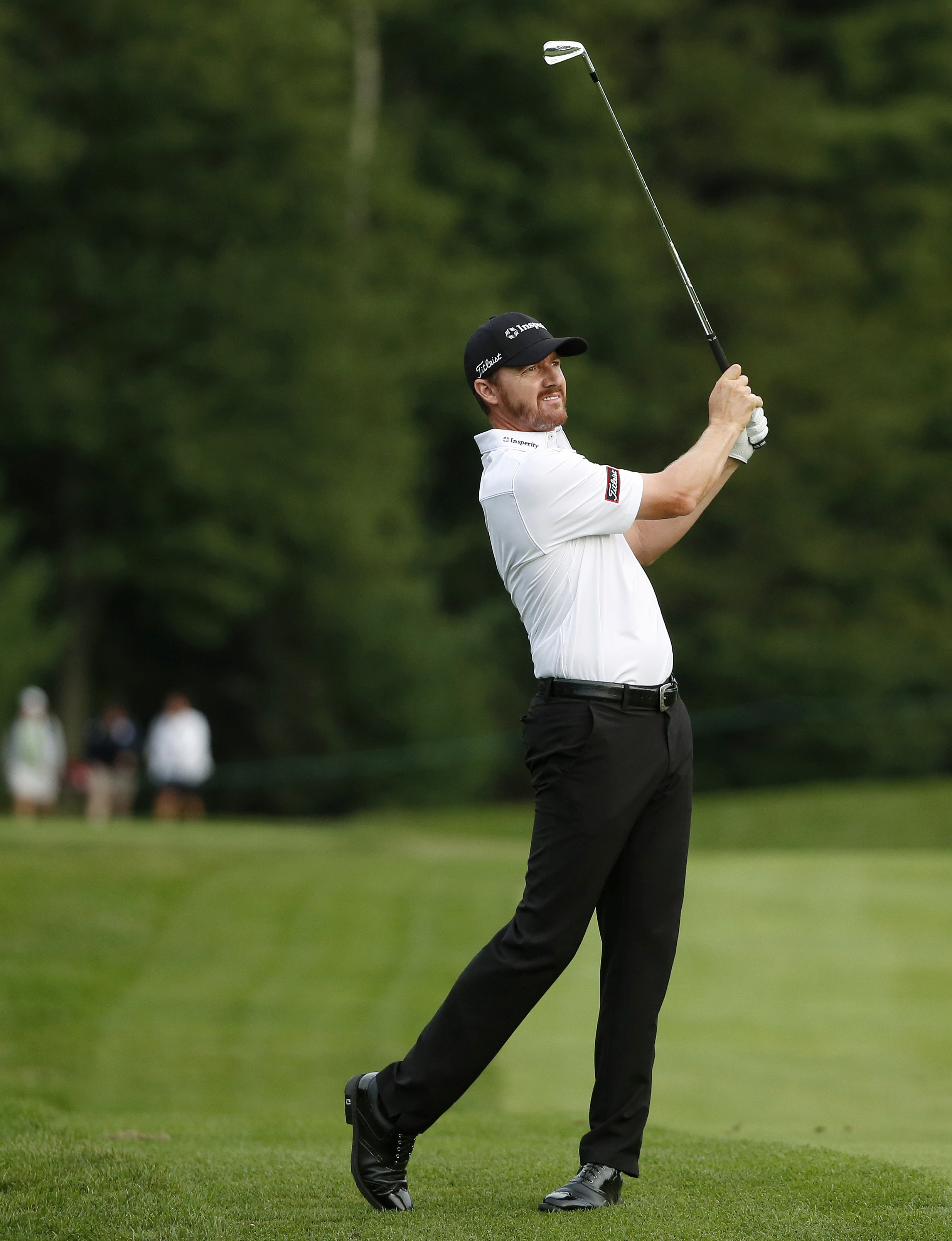 Jimmy Walker watches his shot from the fairway on the ninth hole during the second round of the Deutsche Bank Championship golf tournament, Saturday, Sept. 3, 2016, in Norton, Mass. (AP Photo/Michael Dwyer)