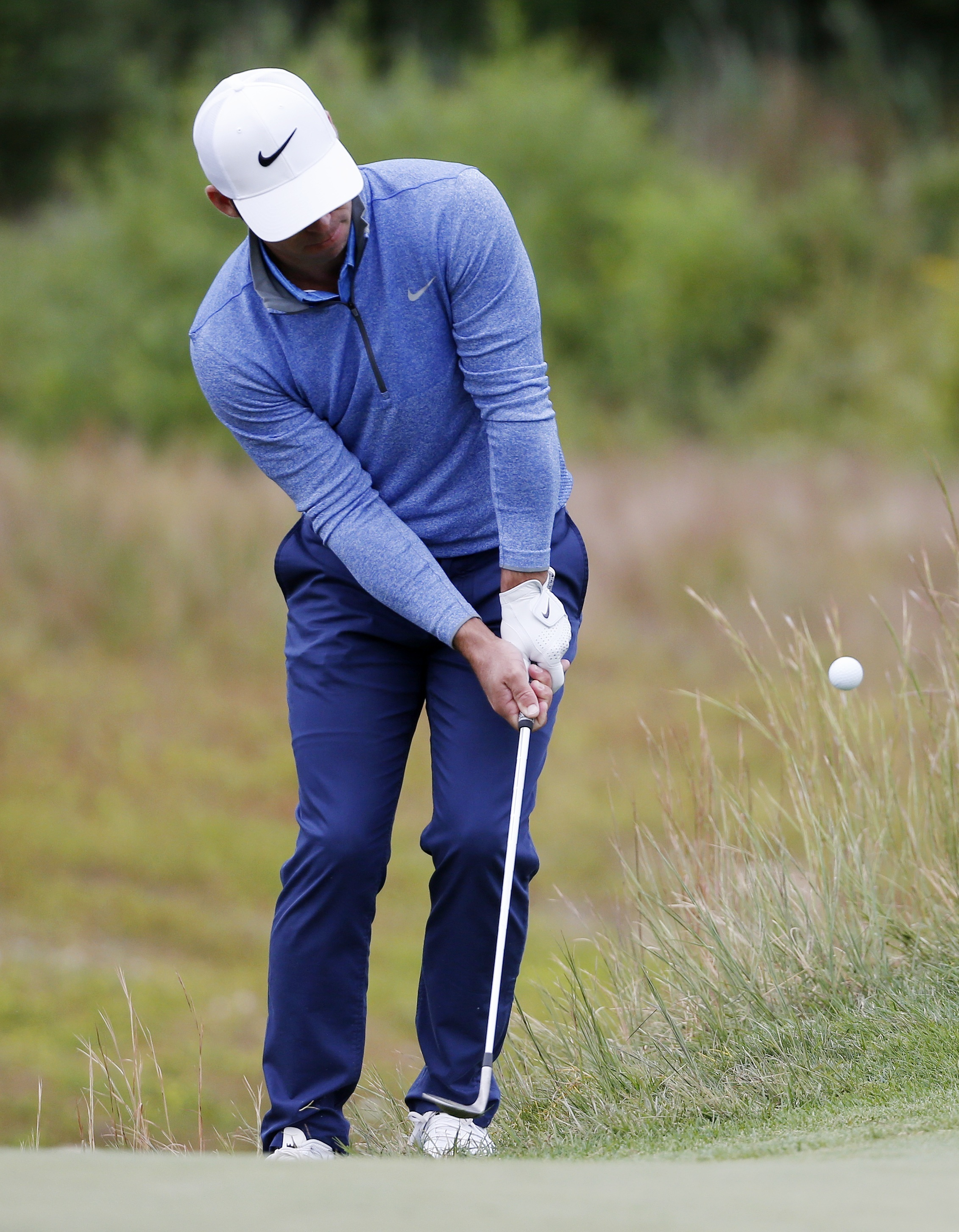 Paul Casey, of England, chips to the second green during the final round of the Deutsche Bank Championship golf tournament in Norton, Mass., Monday, Sept. 5, 2016. (AP Photo/Michael Dwyer)