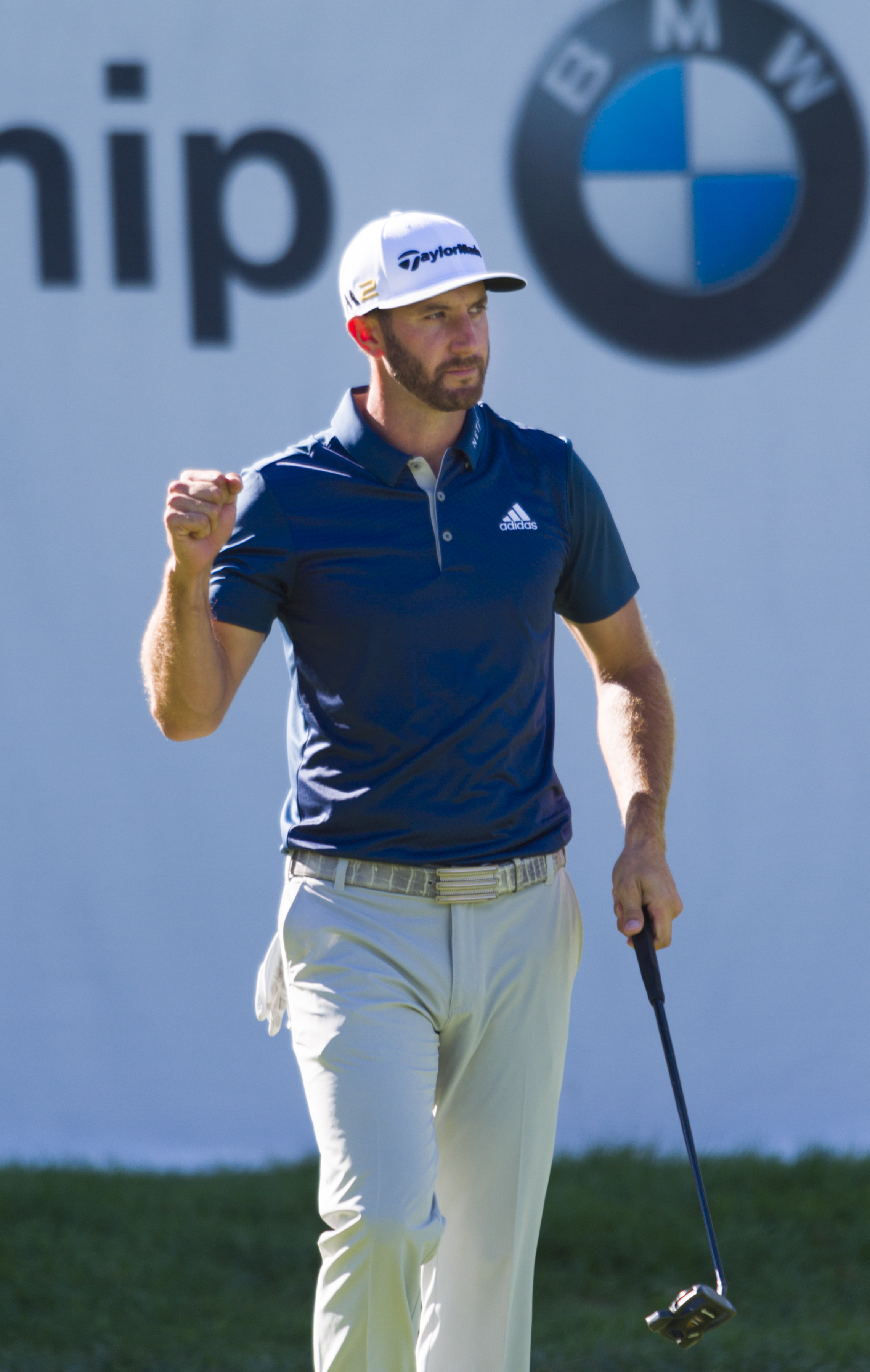 Dustin Johnson reacts after sinking a long putt on the 15th hole during the final round of the BMW Championship golf tournament at Crooked Stick Golf Club in Carmel, Ind., Sunday, Sept. 11, 2016. Johnson won the tournament. (AP Photo/Doug McSchooler)