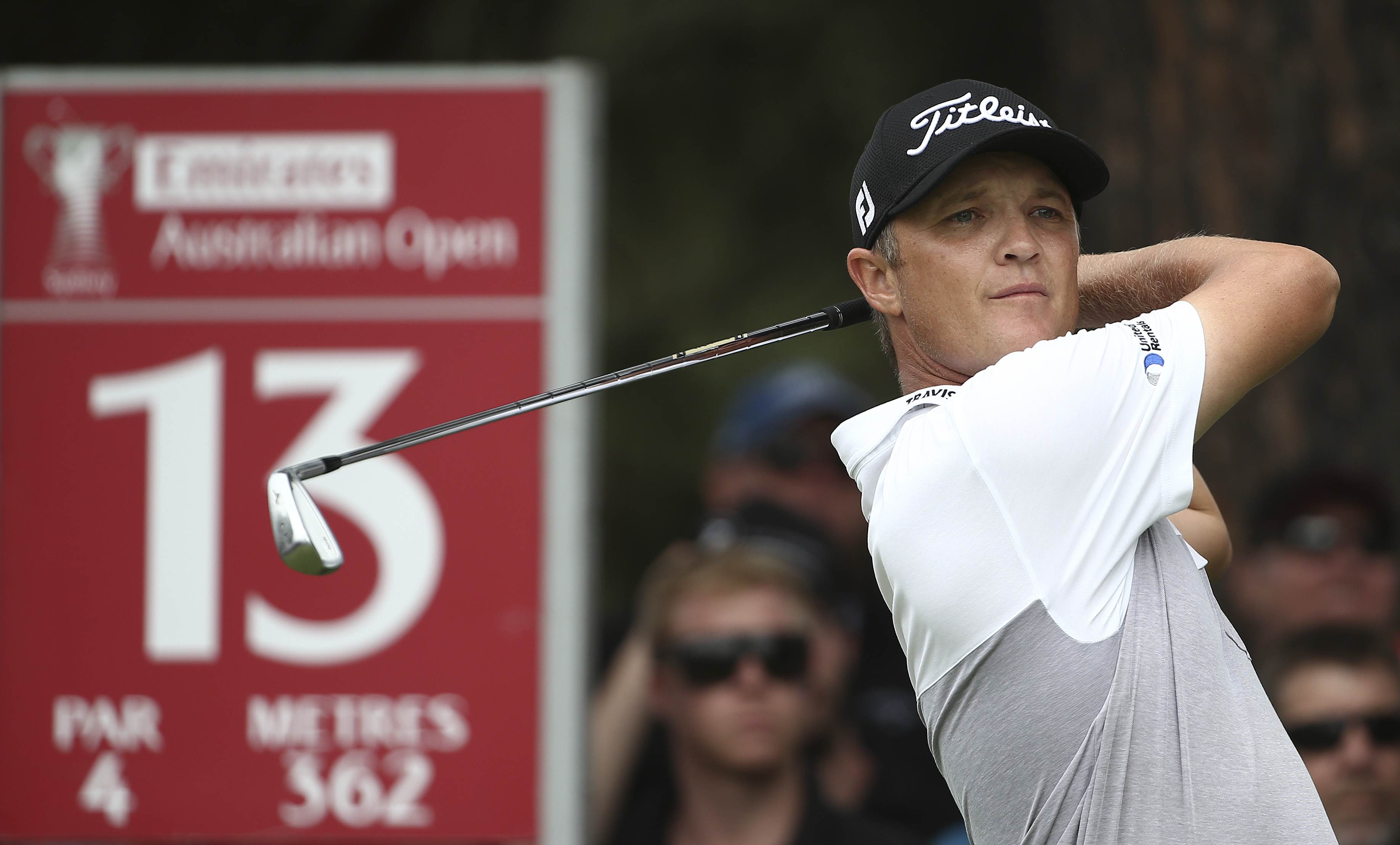 Matthew Jones of Australia tees off on the 13th hole during the Australian Open golf tournament in Sydney Saturday, Nov. 28, 2015. (AP Photo/Rob Griffith)