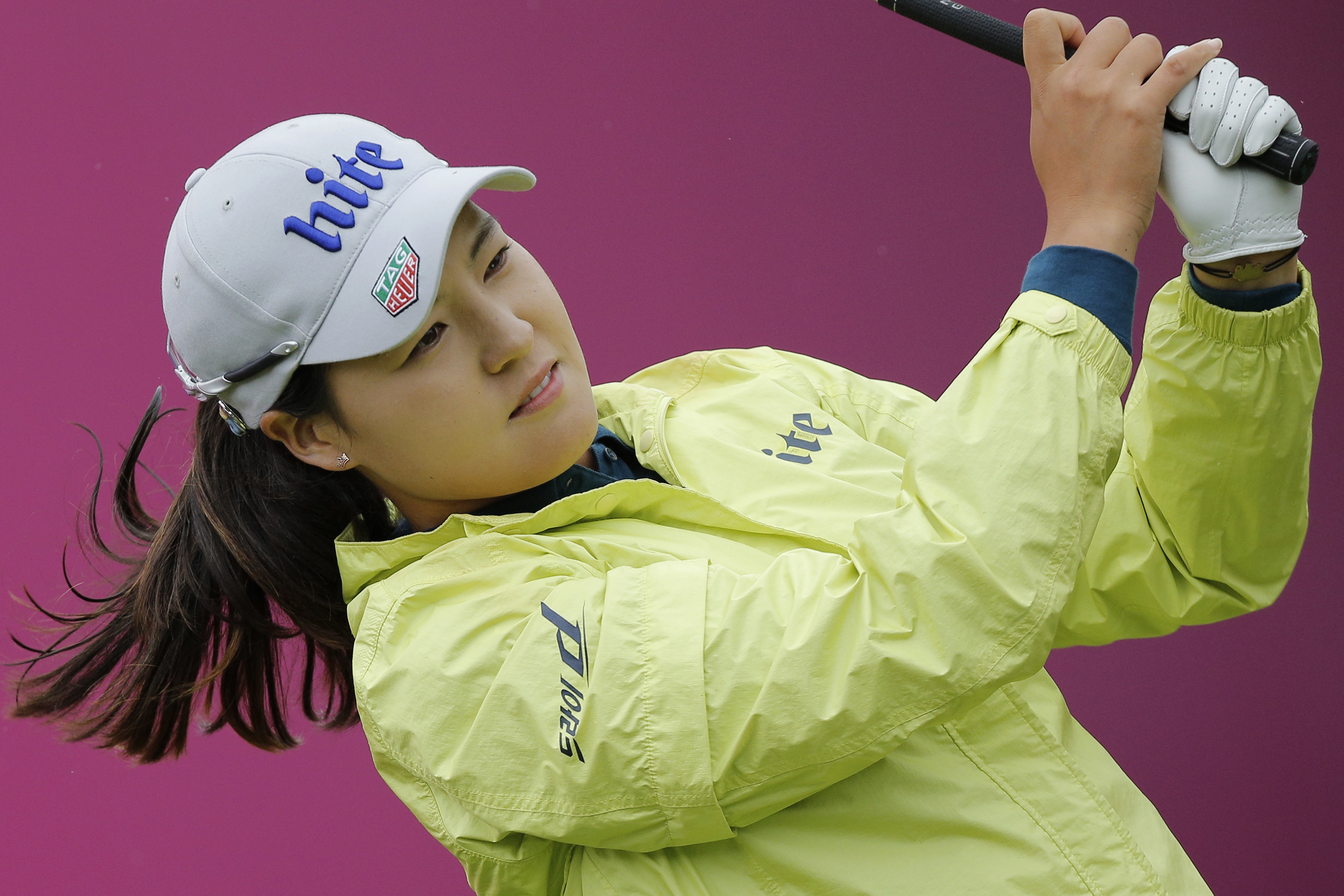 In Gee Chun of South Korea follows the flight of her ball after playing on the 2nd hole during the third round of the Evian Championship women's golf tournament in Evian, eastern France, Saturday, Sept. 17, 2016. (AP Photo/Laurent Cipriani)