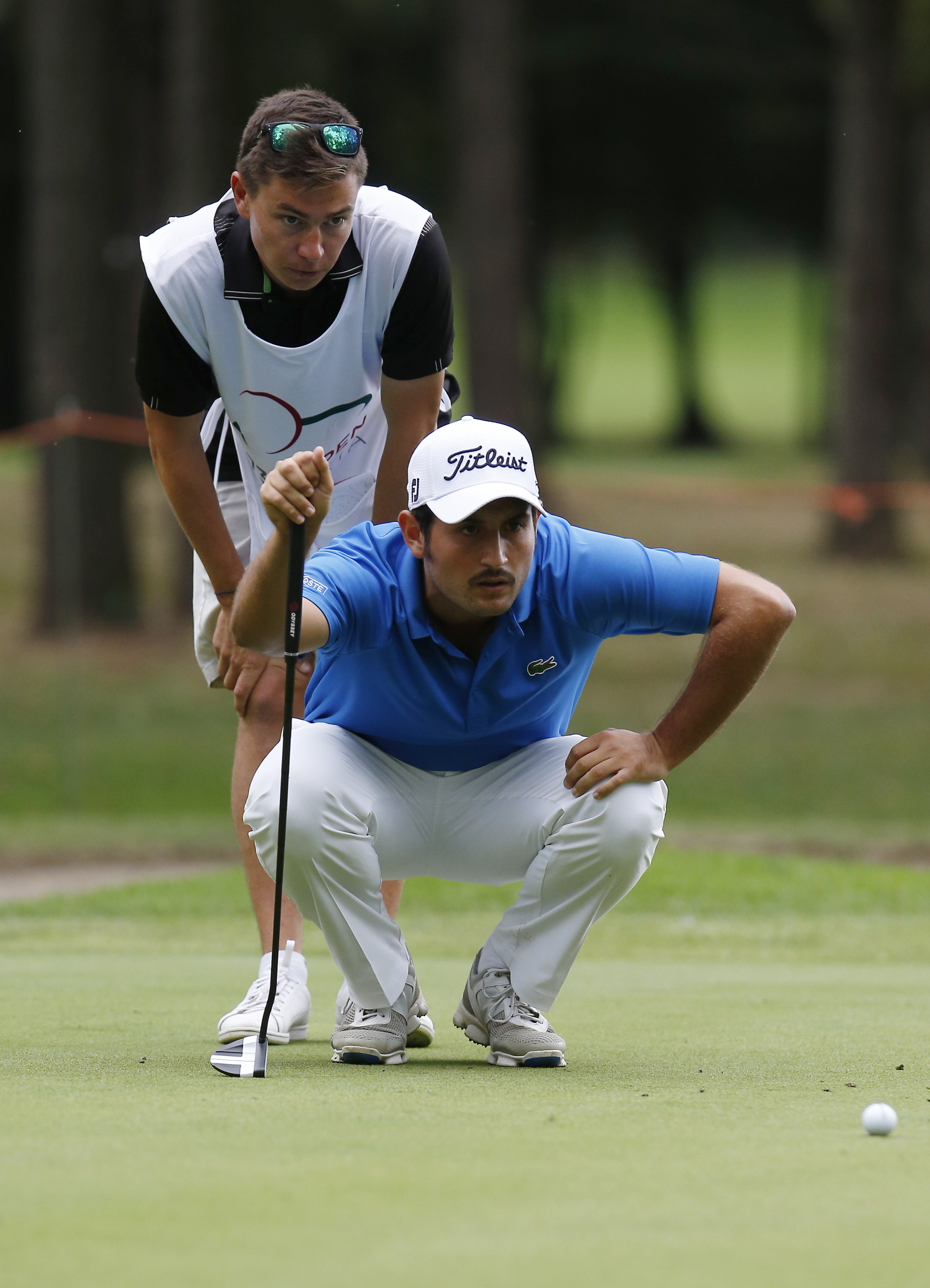 France's Alexander Levy, bottom, analyzes the green during the 73th Italy Open Golf Championship in Monza, Italy, Saturday, Sept. 17, 2016. (AP Photo/Antonio Calanni)