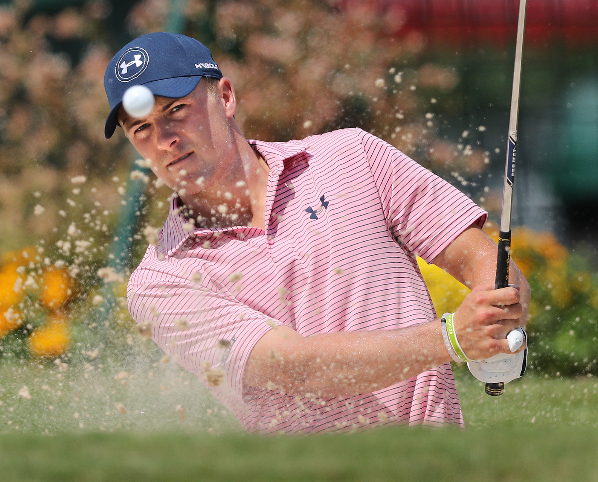 Tour Championship golf tournament defending champion Jordan Spieth hits sand shots to the practice green while preparing to defend his title at East Lake Golf Club in Atlanta,  on Tuesday, Sept. 20, 2016, (Curtis Compton/Atlanta Journal-Constitution via A