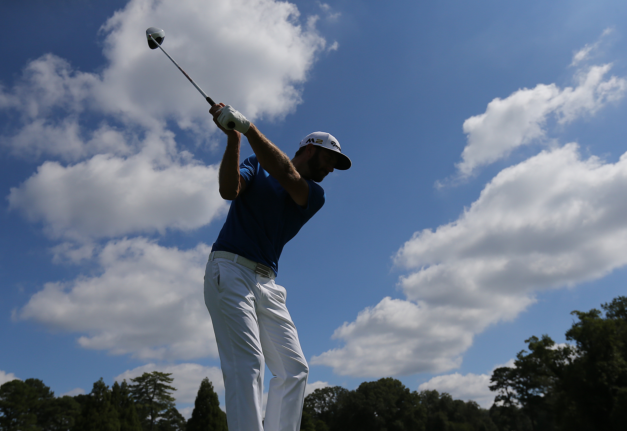 Dustin Johnson tees off on the sixth hole during a practice round for the Tour Championship golf tournament at East Lake Golf Club in Atlanta,  on Tuesday, Sept. 20, 2016, (Curtis Compton/Atlanta Journal-Constitution via AP)