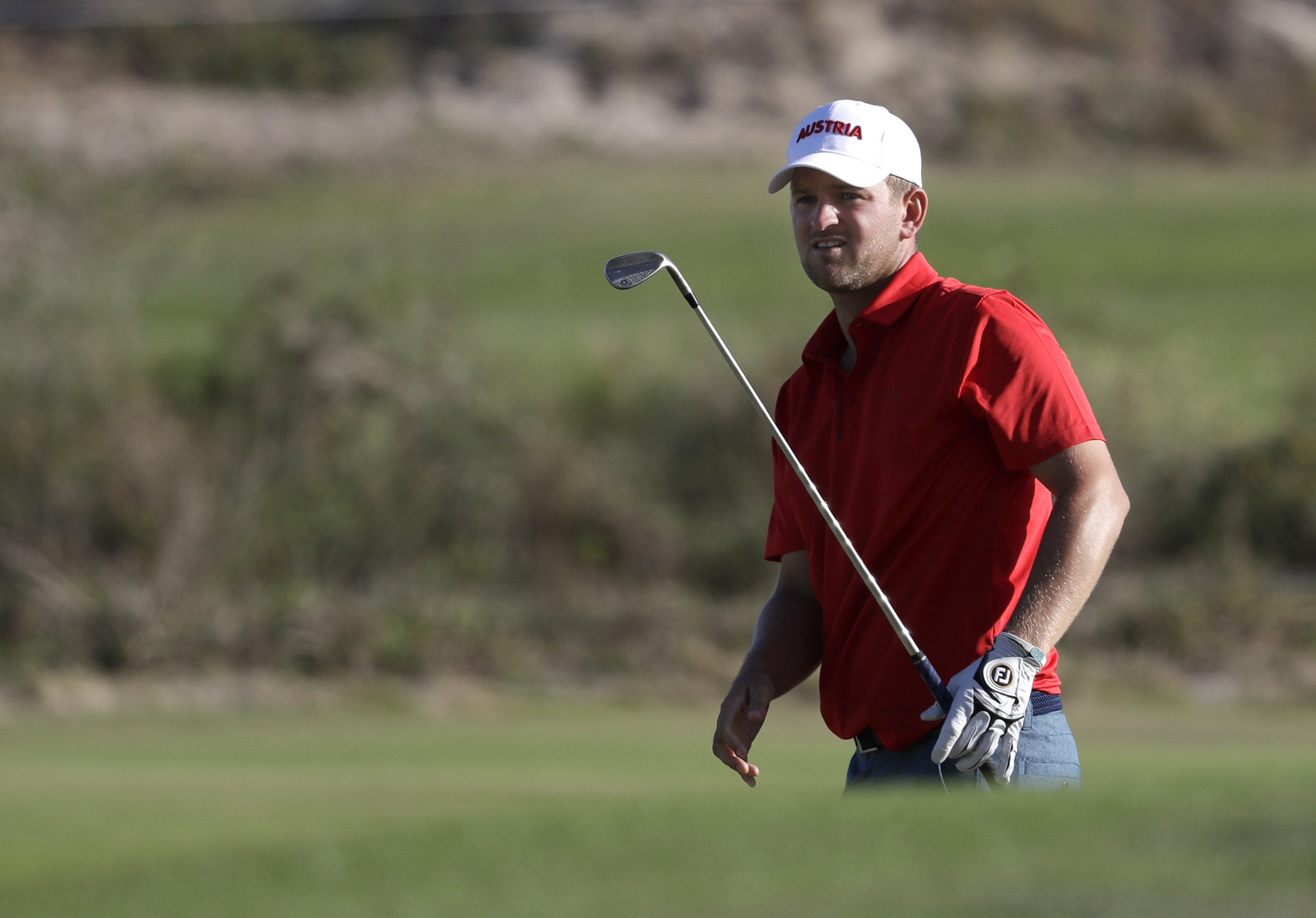 Bernd Wiesberger, of Austria, watches his chip shot to the 18th green during the second round of the men's golf event at the 2016 Summer Olympics in Rio de Janeiro, Brazil, Friday, Aug. 12, 2016. (AP Photo/Alastair Grant)
