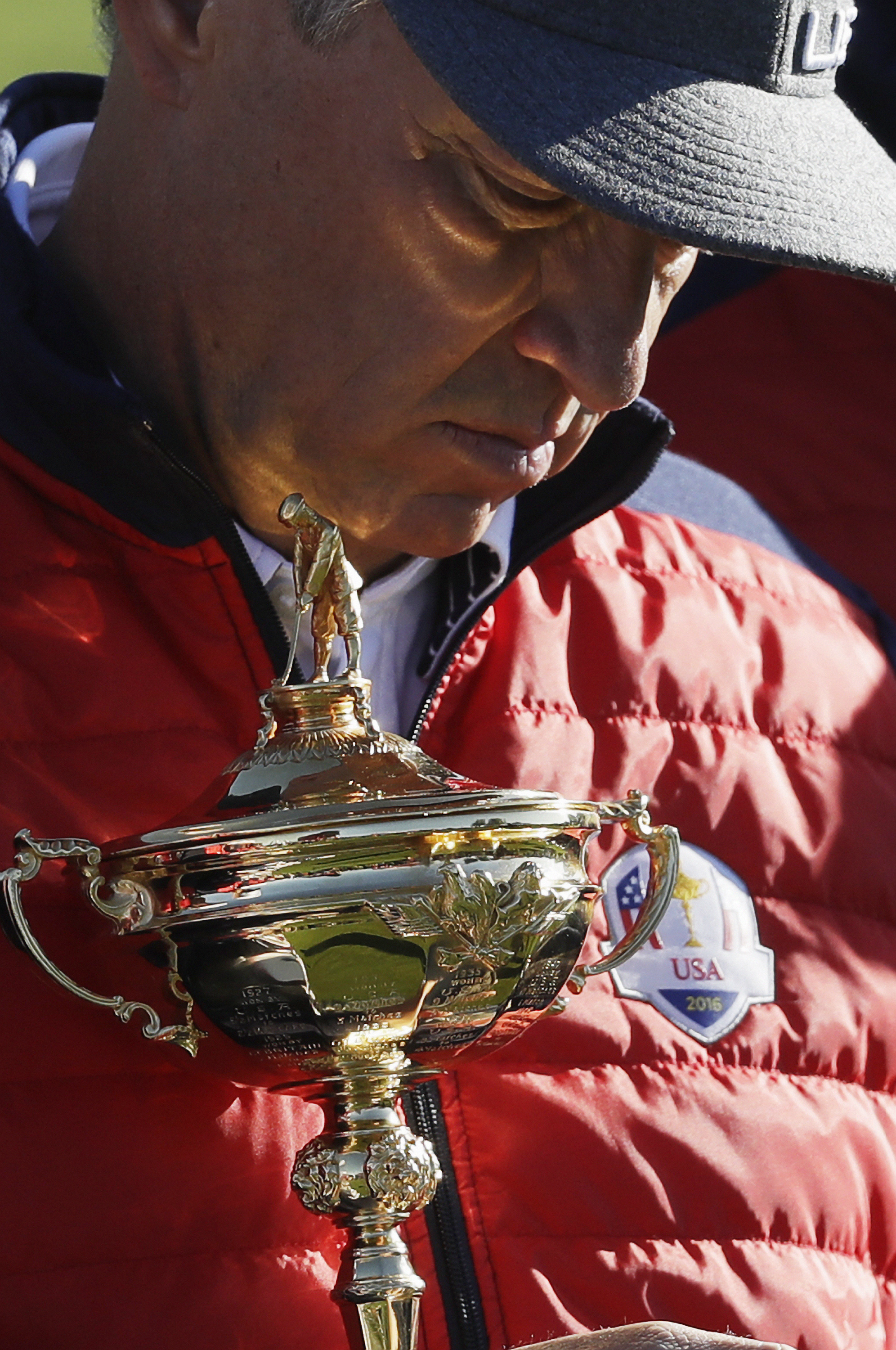 United States captain Davis Love III holds the Ryder Cup before a practice round for the Ryder Cup golf tournament Tuesday, Sept. 27, 2016, at Hazeltine National Golf Club in Chaska, Minn. (AP Photo/Chris Carlson)