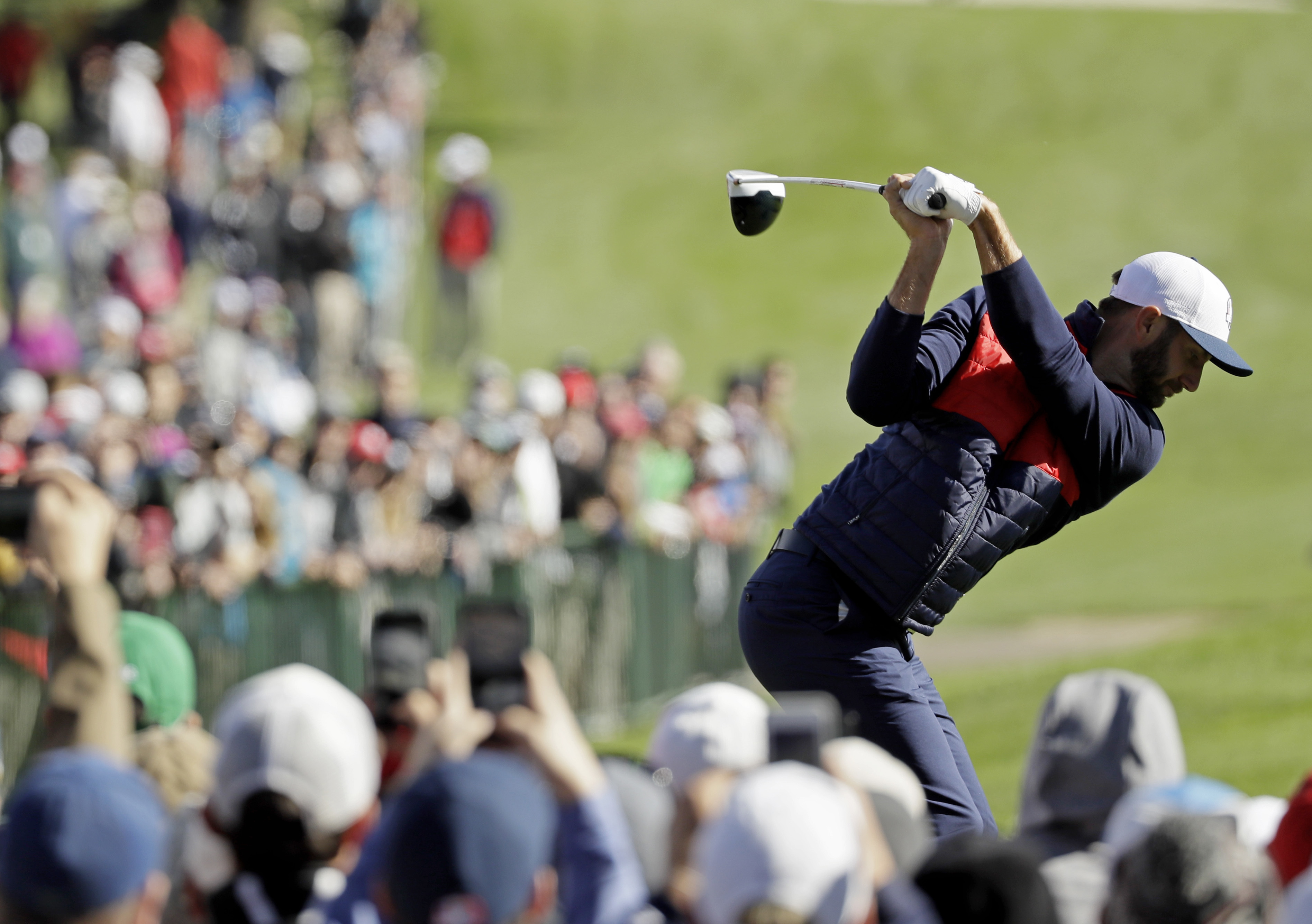 United States' Dustin Johnson hits a drive on the second hole during a practice round for the Ryder Cup golf tournament Tuesday, Sept. 27, 2016, at Hazeltine National Golf Club in Chaska, Minn. (AP Photo/David J. Phillip)
