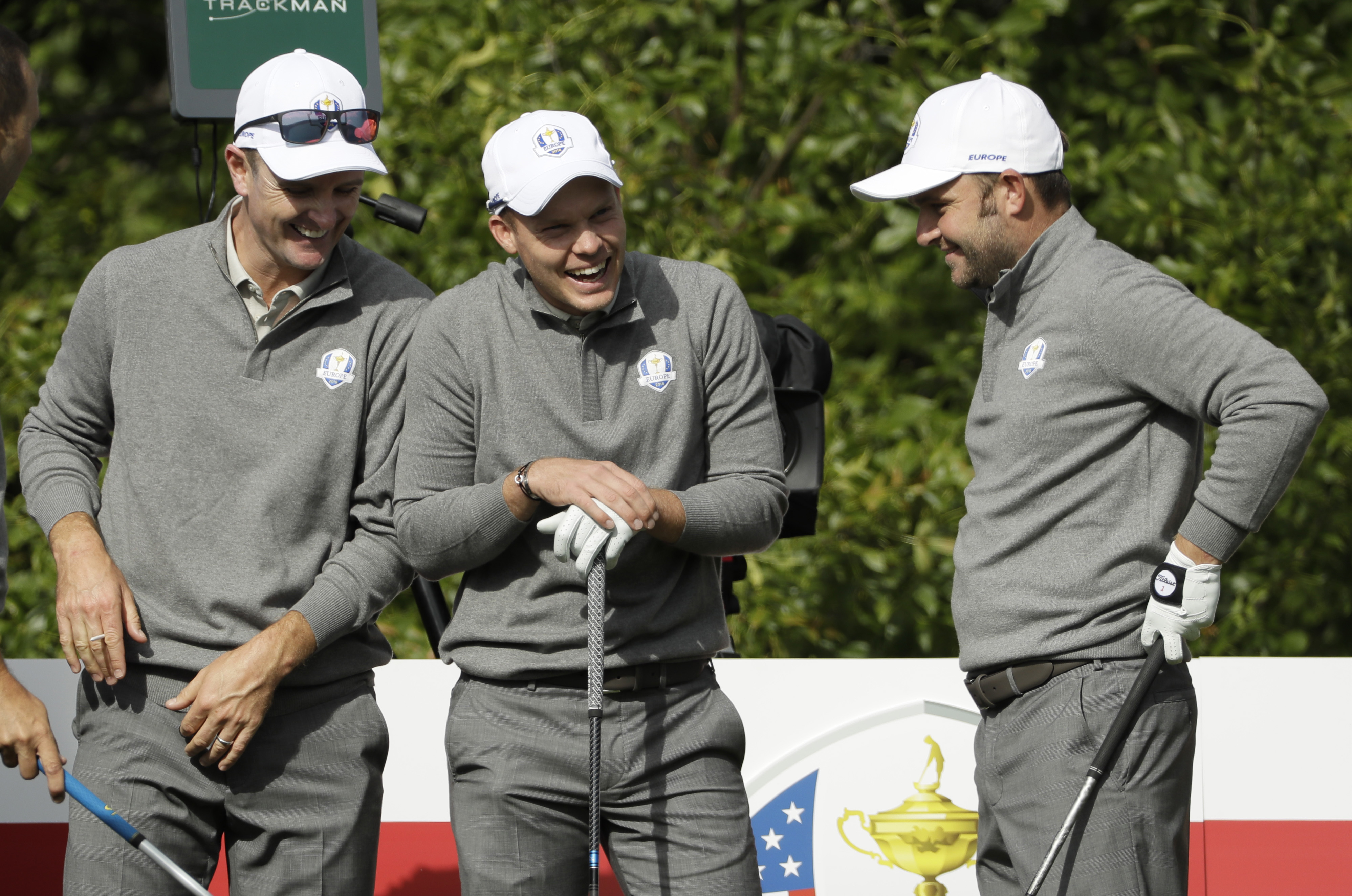 Europe's Justin Rose, left to right, Europe's Danny Willett and Europe's Andy Sullivan have some fun on the 10th tee during a practice round for the Ryder Cup golf tournament Wednesday, Sept. 28, 2016, at Hazeltine National Golf Club in Chaska, Minn. (AP