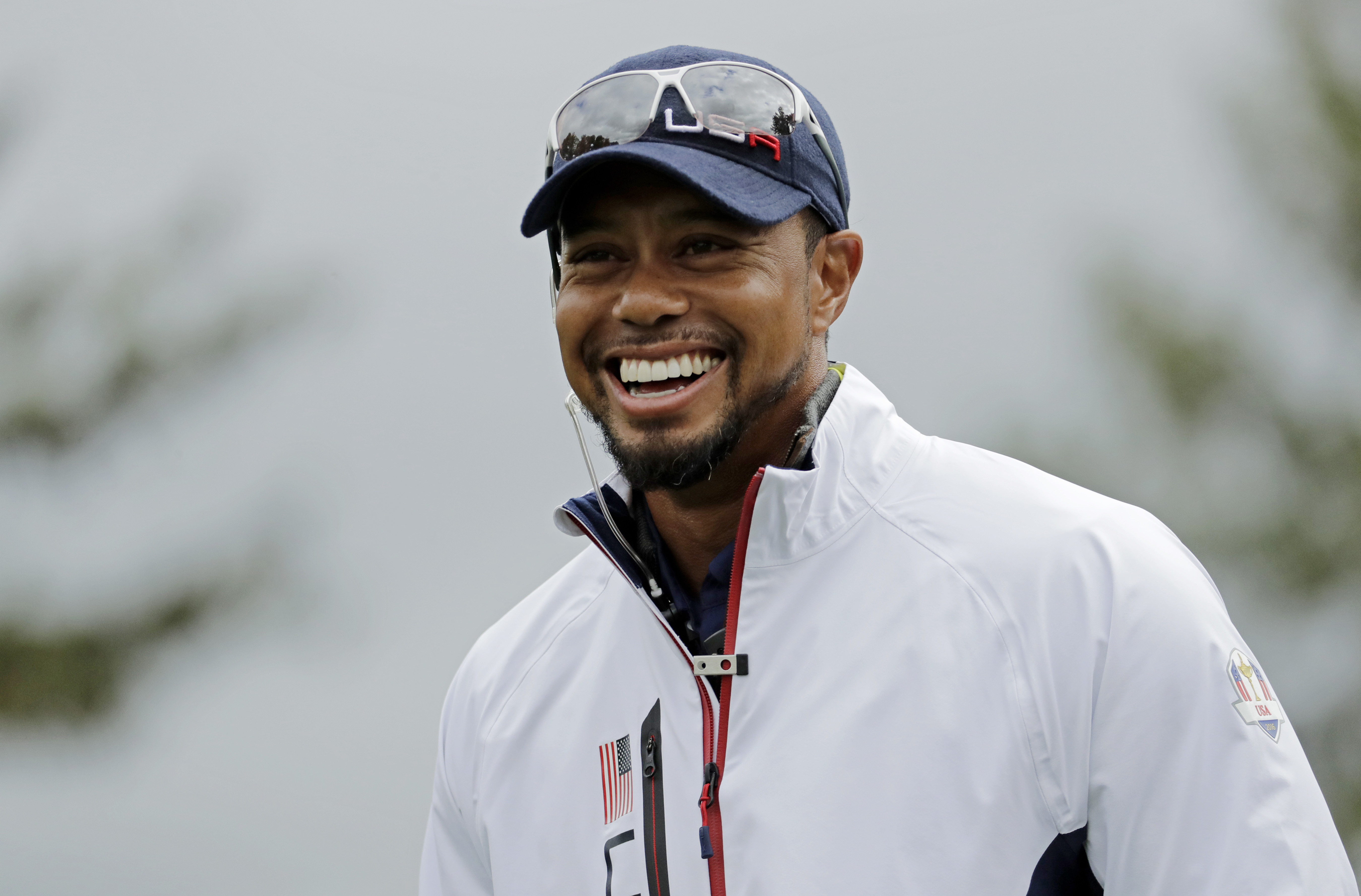 United States vice-captain Tiger Woods smiles during a practice round for the Ryder Cup golf tournament Wednesday, Sept. 28, 2016, at Hazeltine National Golf Club in Chaska, Minn. (AP Photo/Charlie Riedel)