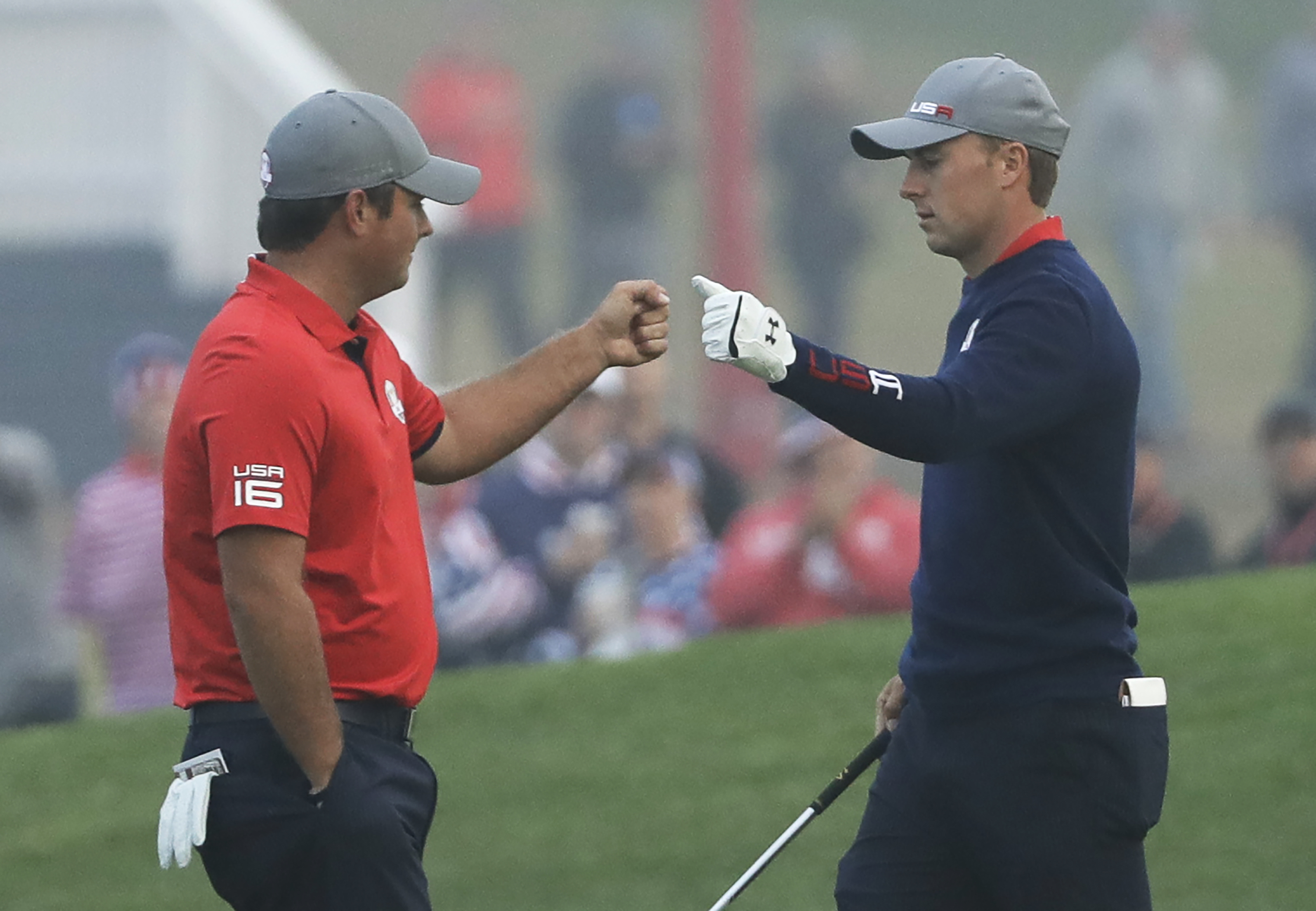 United States' Patrick Reed fist pumps teammate Jordan Spieth on the first hole during a foresomes match at the Ryder Cup golf tournament Friday, Sept. 30, 2016, at Hazeltine National Golf Club in Chaska, Minn. (AP Photo/David J. Phillip)