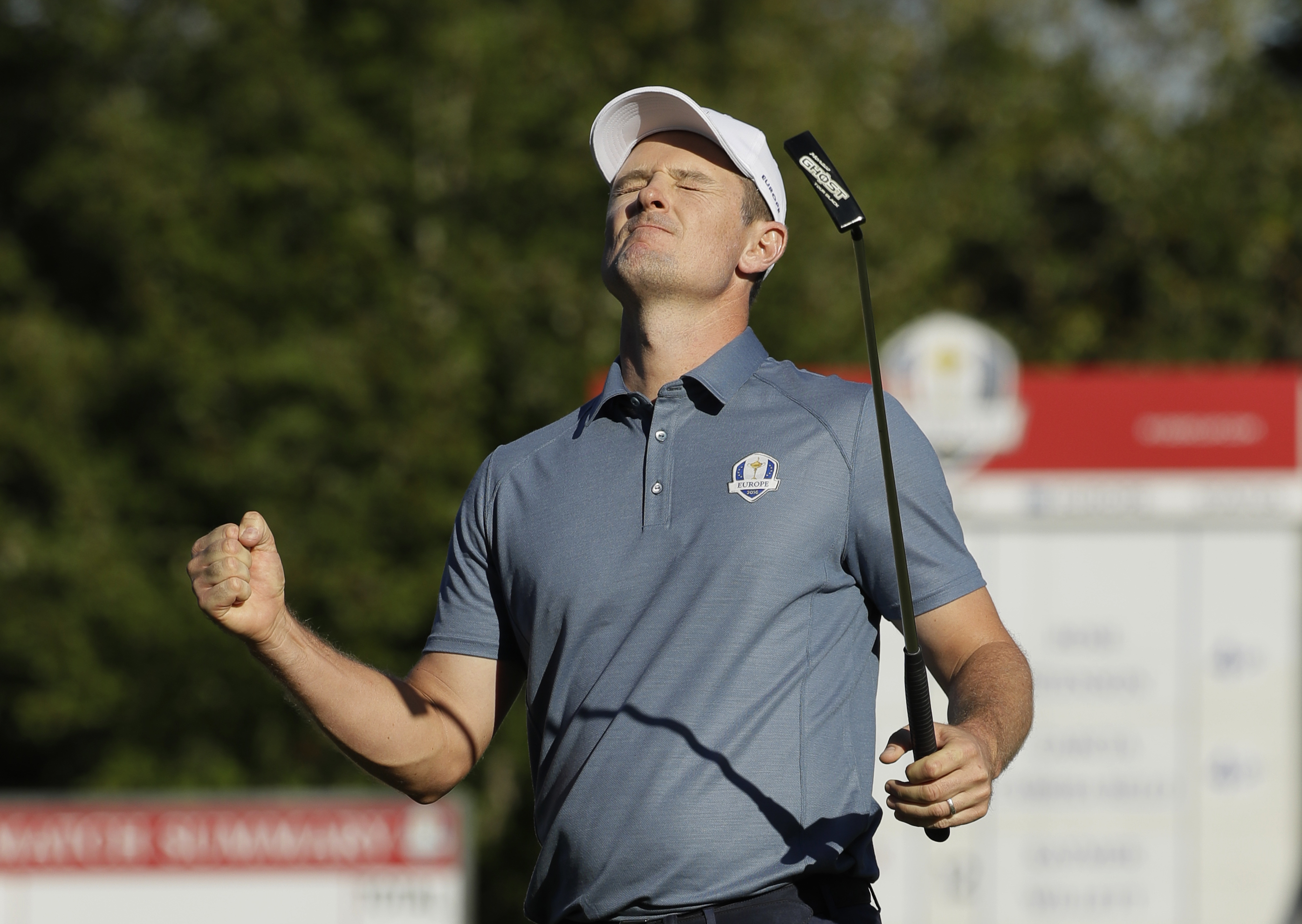 Europes Justin Rose reacts after making a birdie on the 14th hole to win the match during a four-balls match at the Ryder Cup golf tournament Friday, Sept. 30, 2016, at Hazeltine National Golf Club in Chaska, Minn. (AP Photo/David J. Phillip)