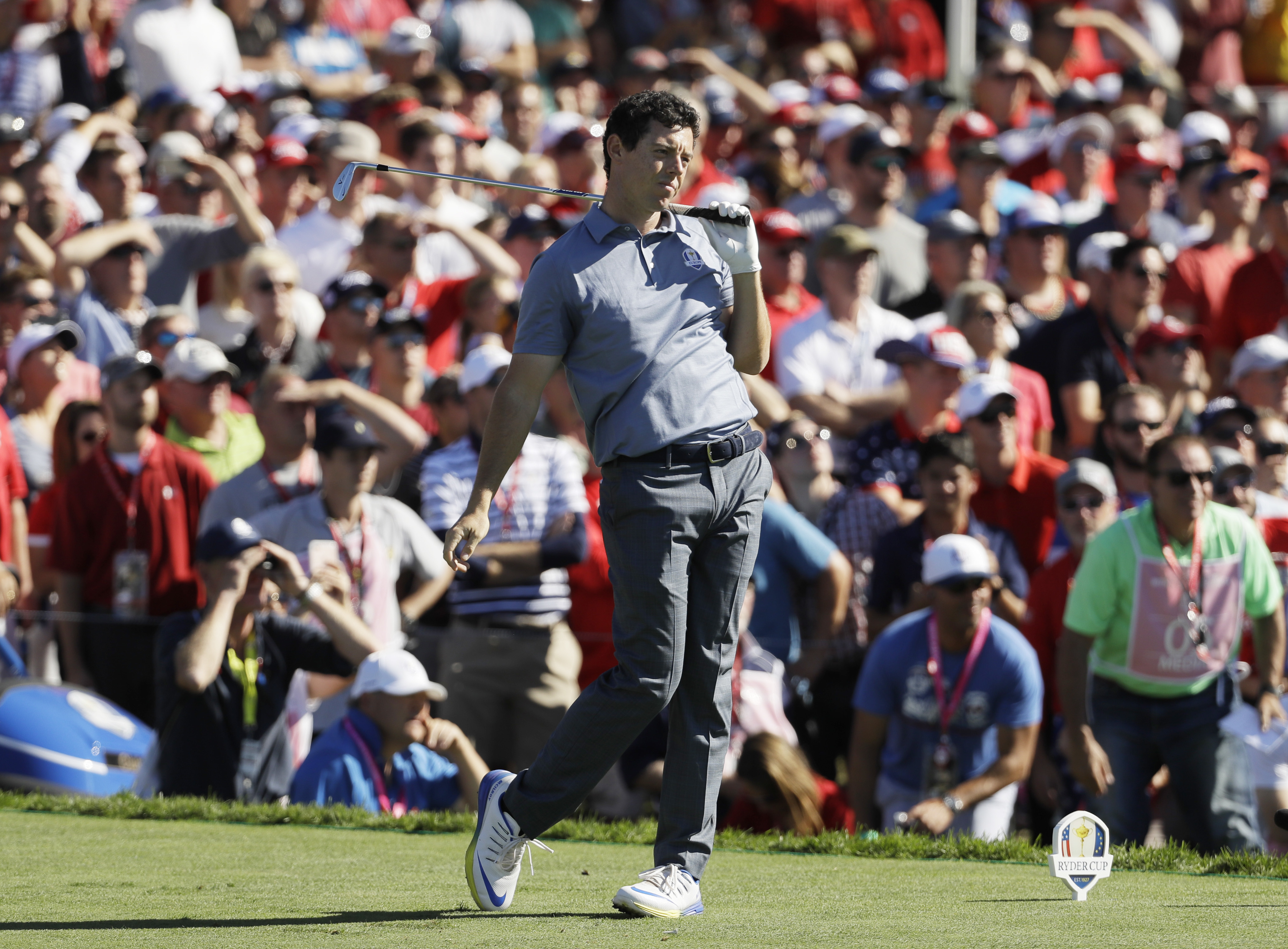 Europes Rory McIlroy watches his shot on the 17th hole during a singles match at the Ryder Cup golf tournament Sunday, Oct. 2, 2016, at Hazeltine National Golf Club in Chaska, Minn. (AP Photo/David J. Phillip)