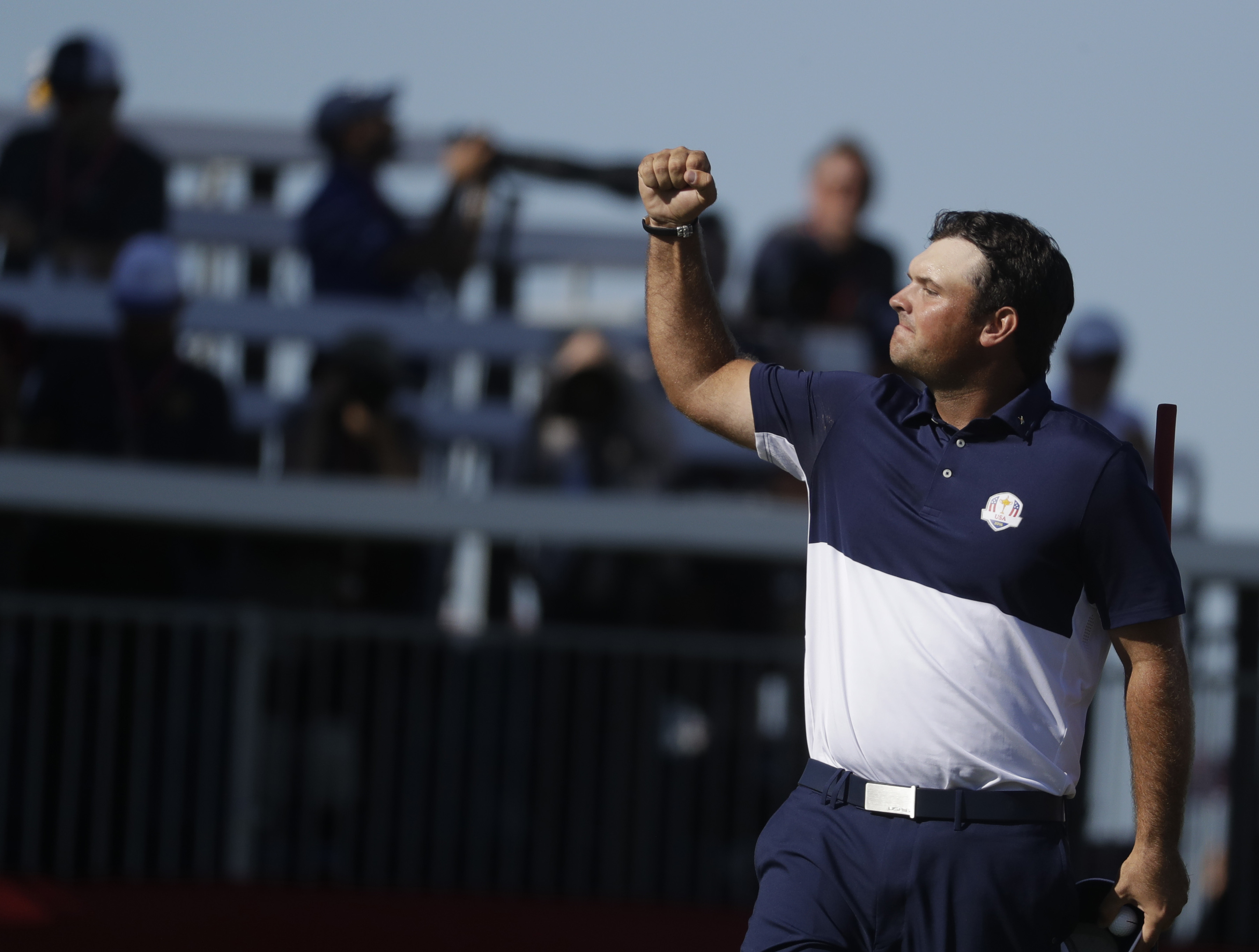 United States Patrick Reed reacts after defeating Europes Rory McIlroy on the 18th hole during a singles match at the Ryder Cup golf tournament Sunday, Oct. 2, 2016, at Hazeltine National Golf Club in Chaska, Minn. (AP Photo/Chris Carlson)
