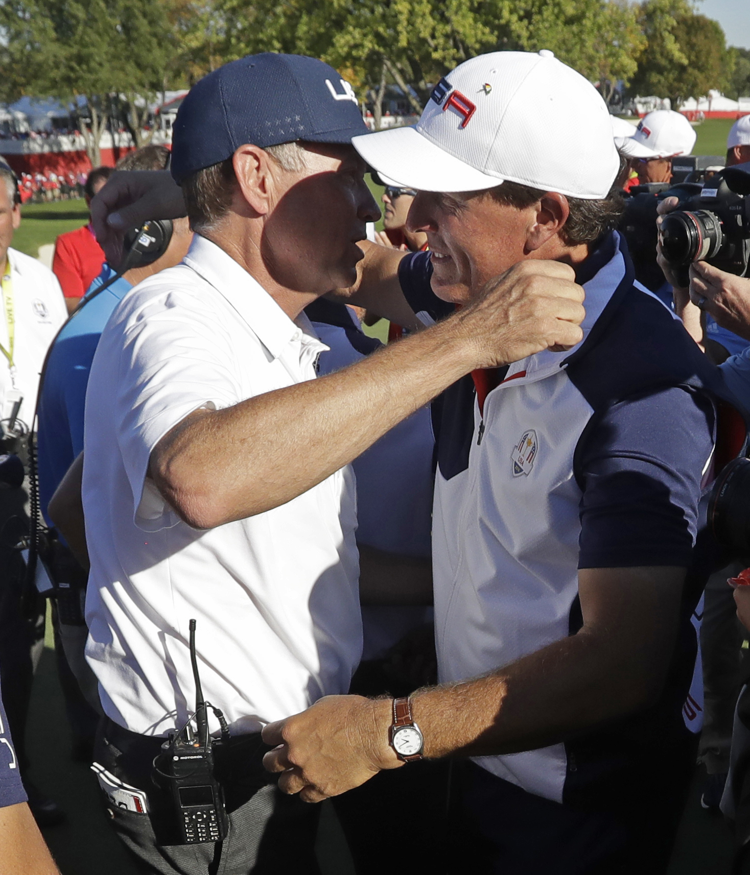 United States captain Davis Love III hugs United States Phil Mickelson after the USA team won the Ryder Cup golf tournament Sunday, Oct. 2, 2016, at Hazeltine National Golf Club in Chaska, Minn. (AP Photo/Chris Carlson)