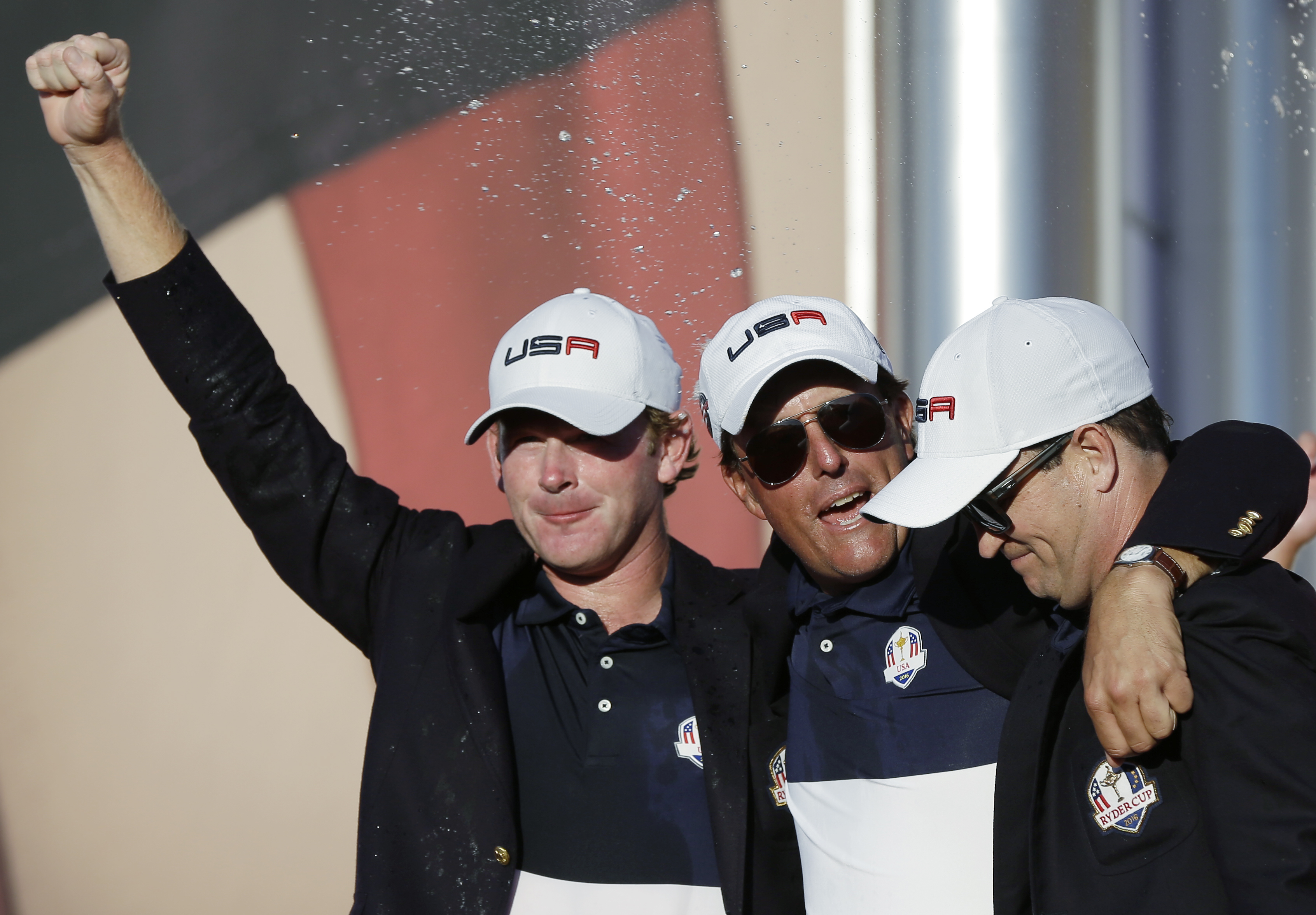 United States Brandt Snedeker, United States Phil Mickelson and United States Dustin Johnson celebrate during the closing ceremony of the Ryder Cup golf tournament Sunday, Oct. 2, 2016, at Hazeltine National Golf Club in Chaska, Minn. (AP Photo/David J. P