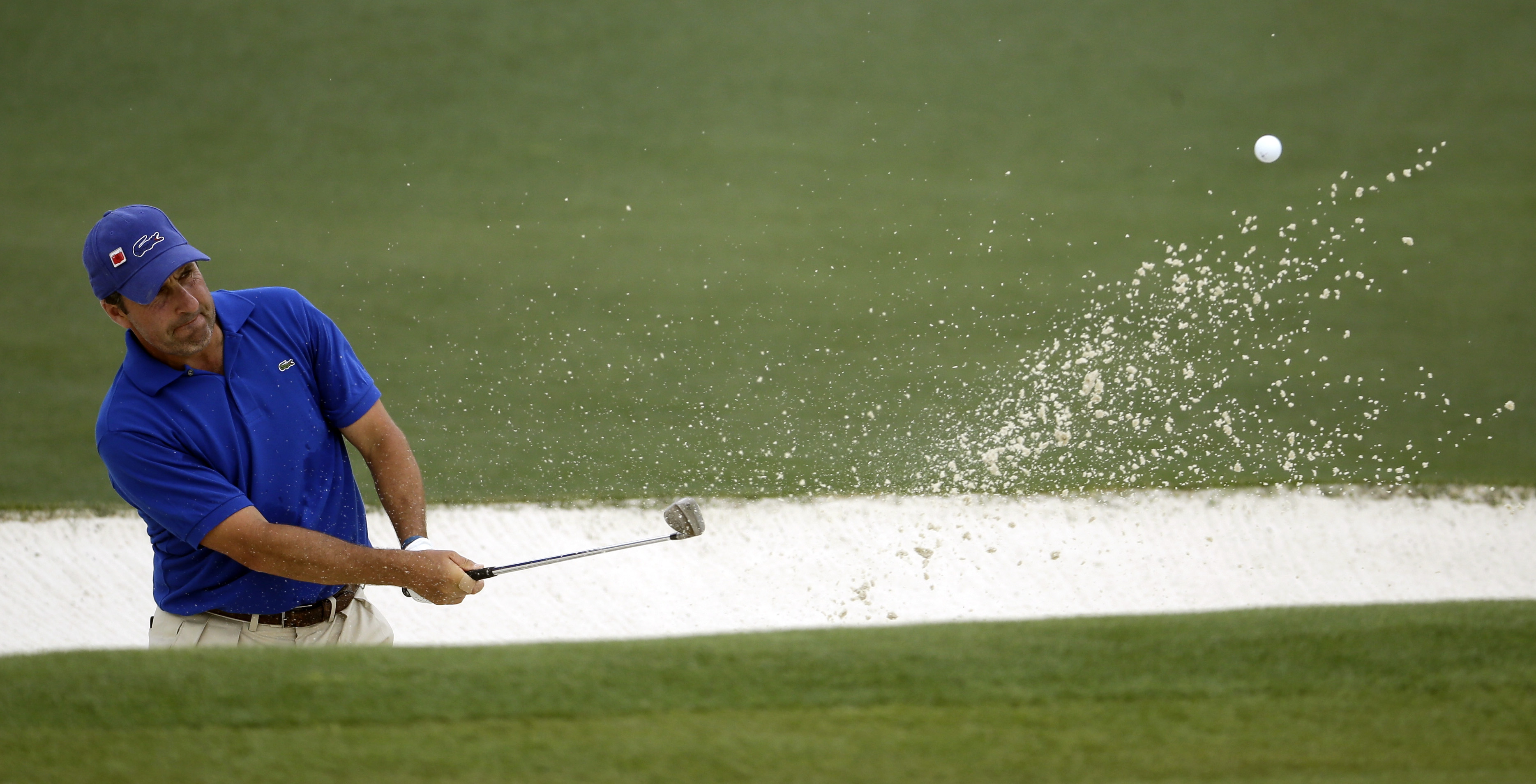 Jose Maria Olazabal, of Spain, hits to the second green during the second round of the Masters golf tournament Friday, April 10, 2015, in Augusta, Ga. (AP Photo/Darron Cummings)