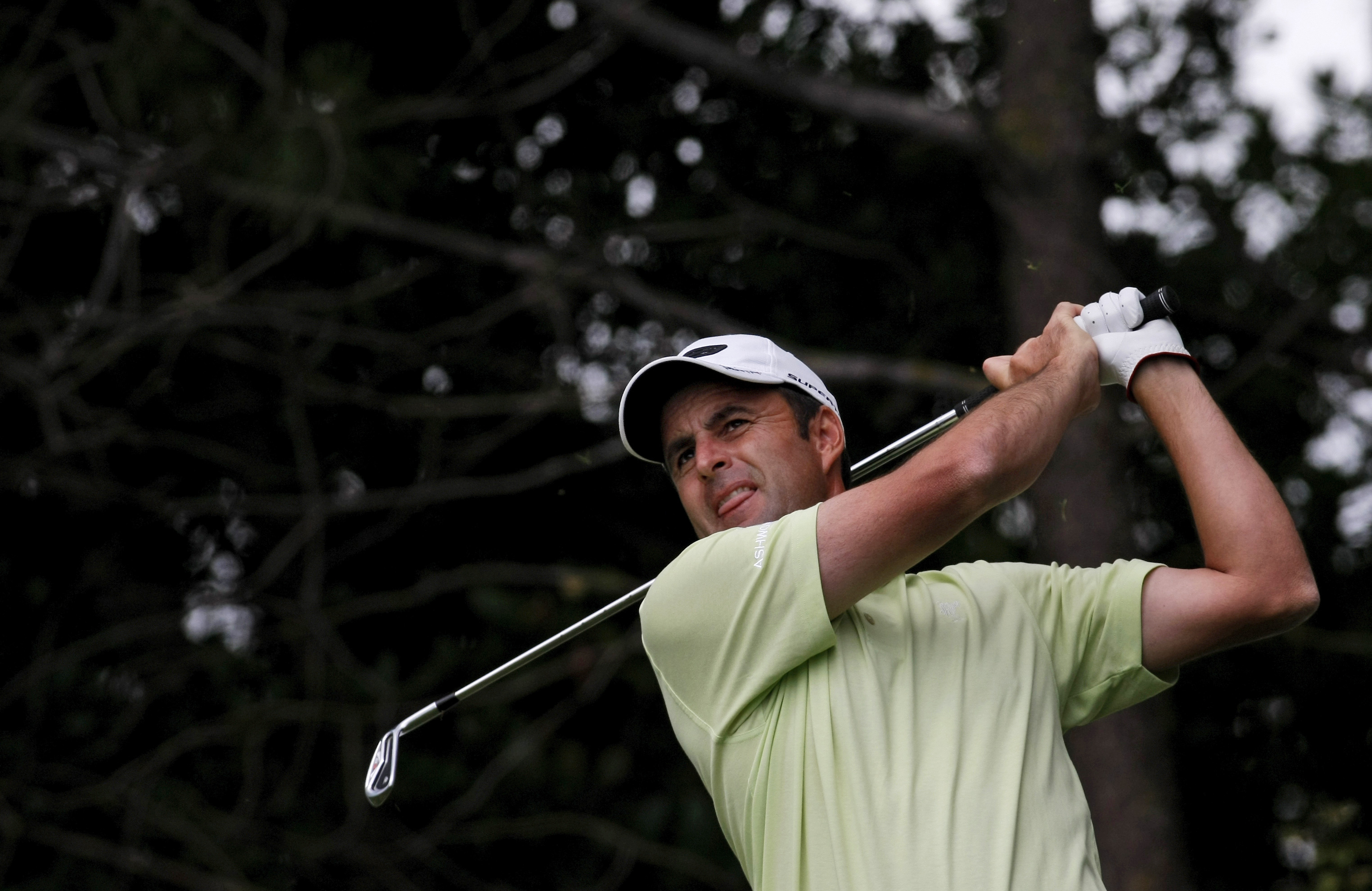 Britain's Richard Bland plays a shot from the 17th hole during the first round of the Estoril Open golf tournament in Sintra, Portugal on Thursday, June 10, 2010. (AP Photo/ Francisco Seco)