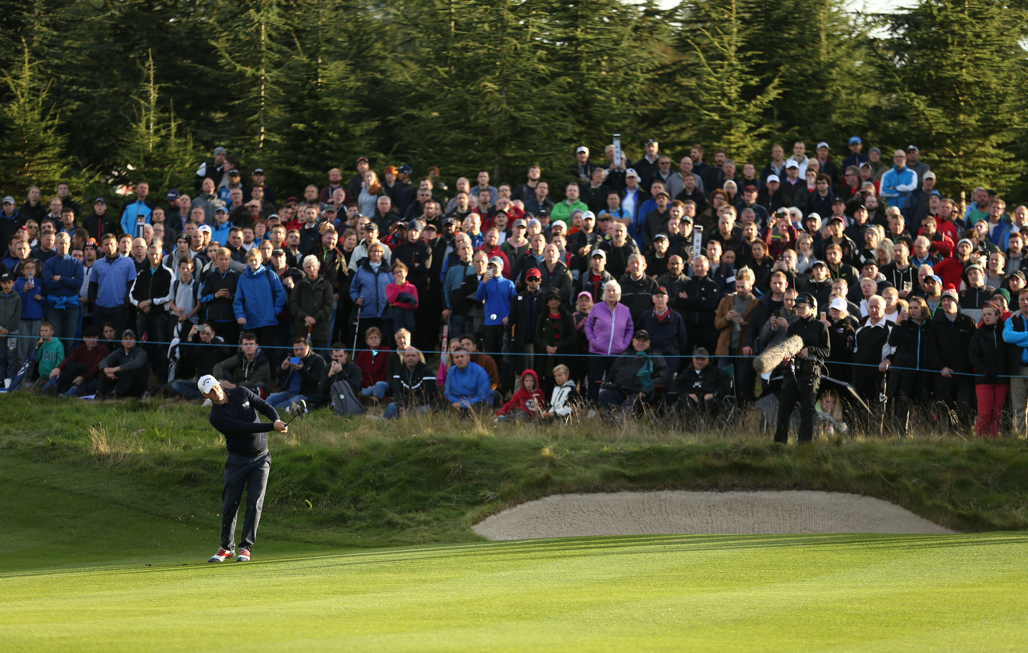 Sweden's Alex Noren plays onto the 18th during day four of The British Masters golf tournament at The Grove, Chandler's Cross, England, Sunday Oct. 16, 2016. Noren won the British Masters. (Steven Paston / PA via AP)