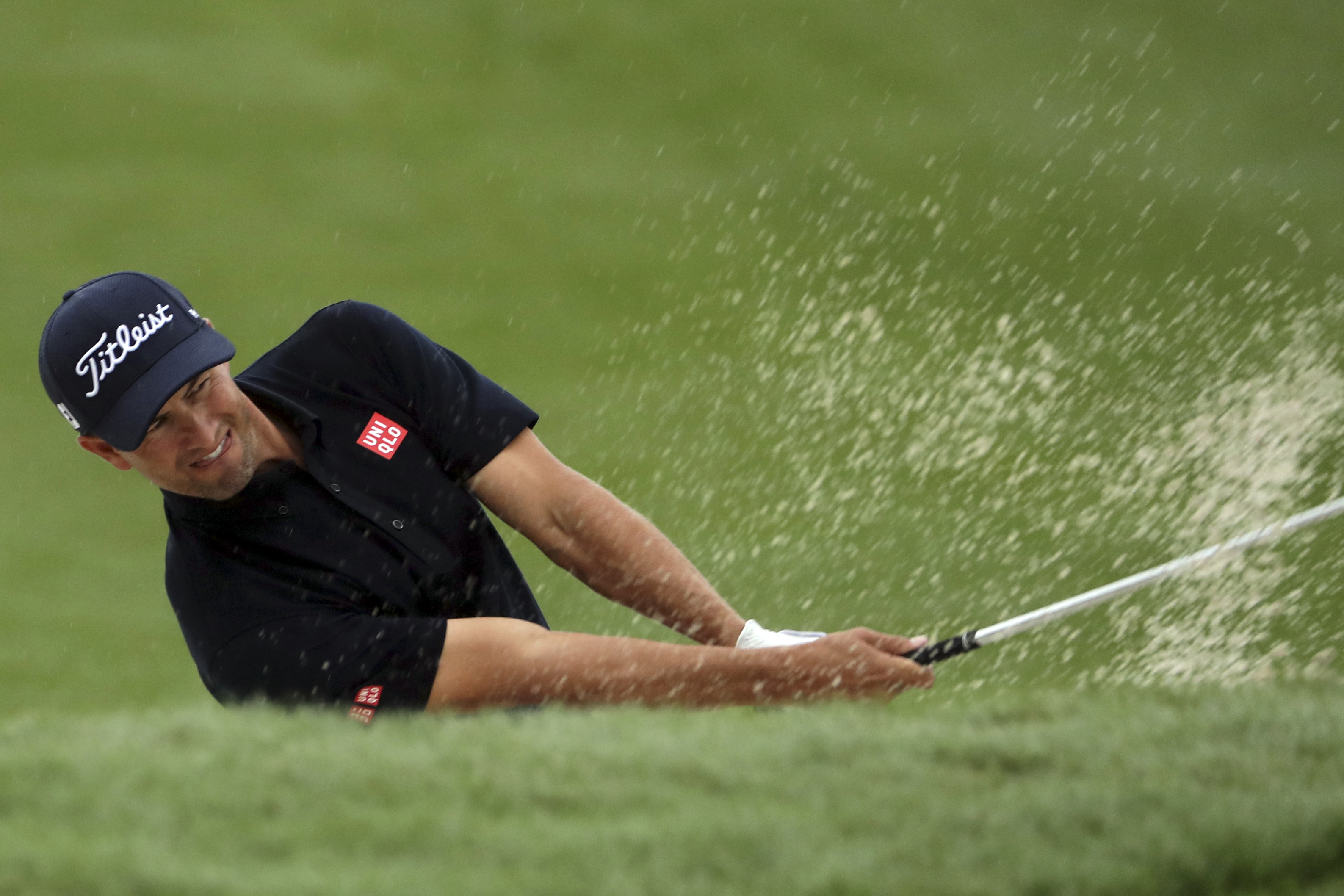 Adam Scott of Australia hits the ball from a sand bank during the WGC-HSBC Champions golf tournament at the Sheshan International Golf Club in Shanghai, China, Thursday, Oct. 27, 2016. (AP Photo/Ng Han Guan)