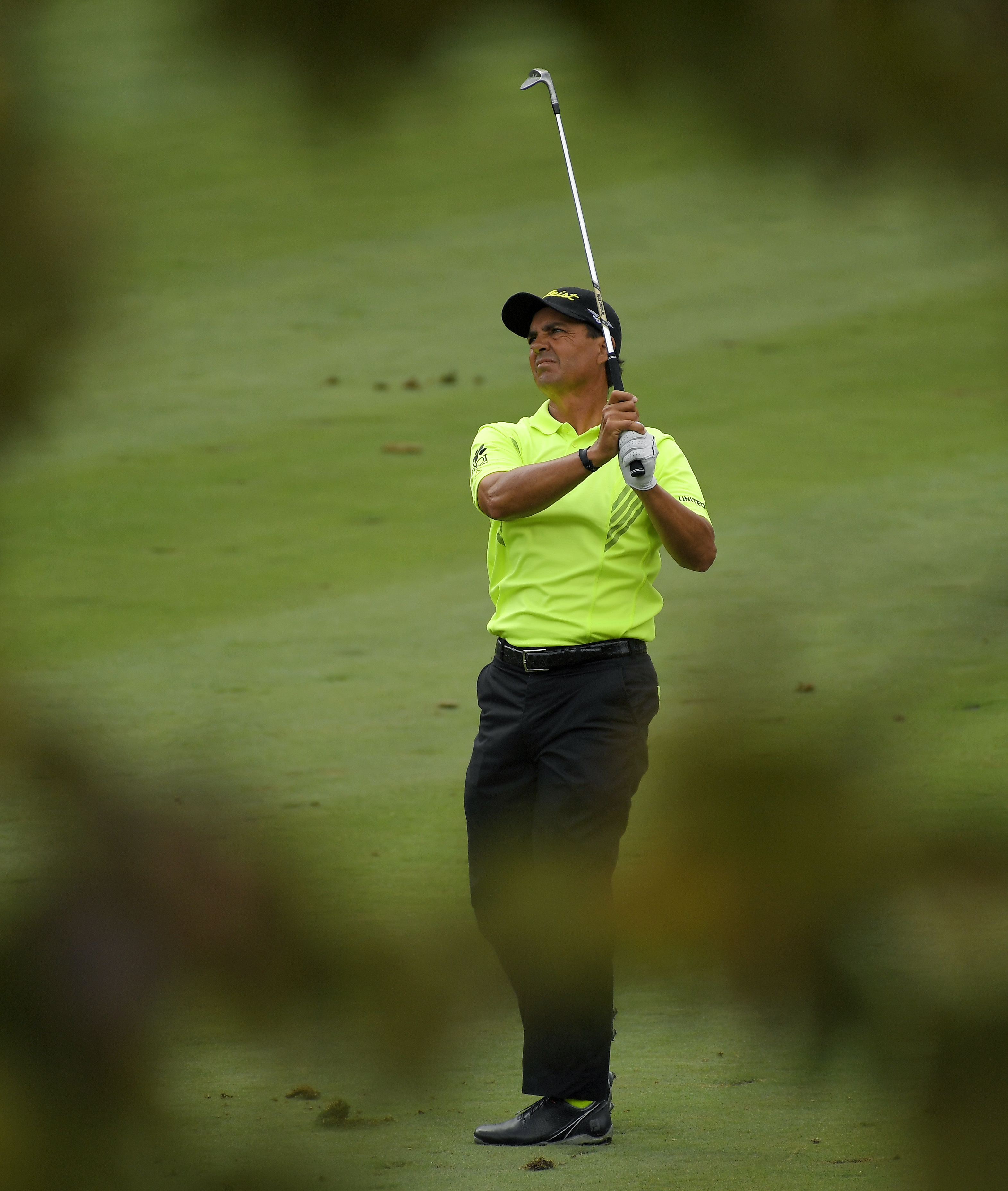 Tom Pernice Jr. is seen through trees as hits from the fairway on the second hole during the final round of the PowerShares QQQ Championship golf tournament, Sunday, Oct. 30, 2016, at Sherwood Country Club in Thousand Oaks, Calif. (AP Photo/Mark J. Terril