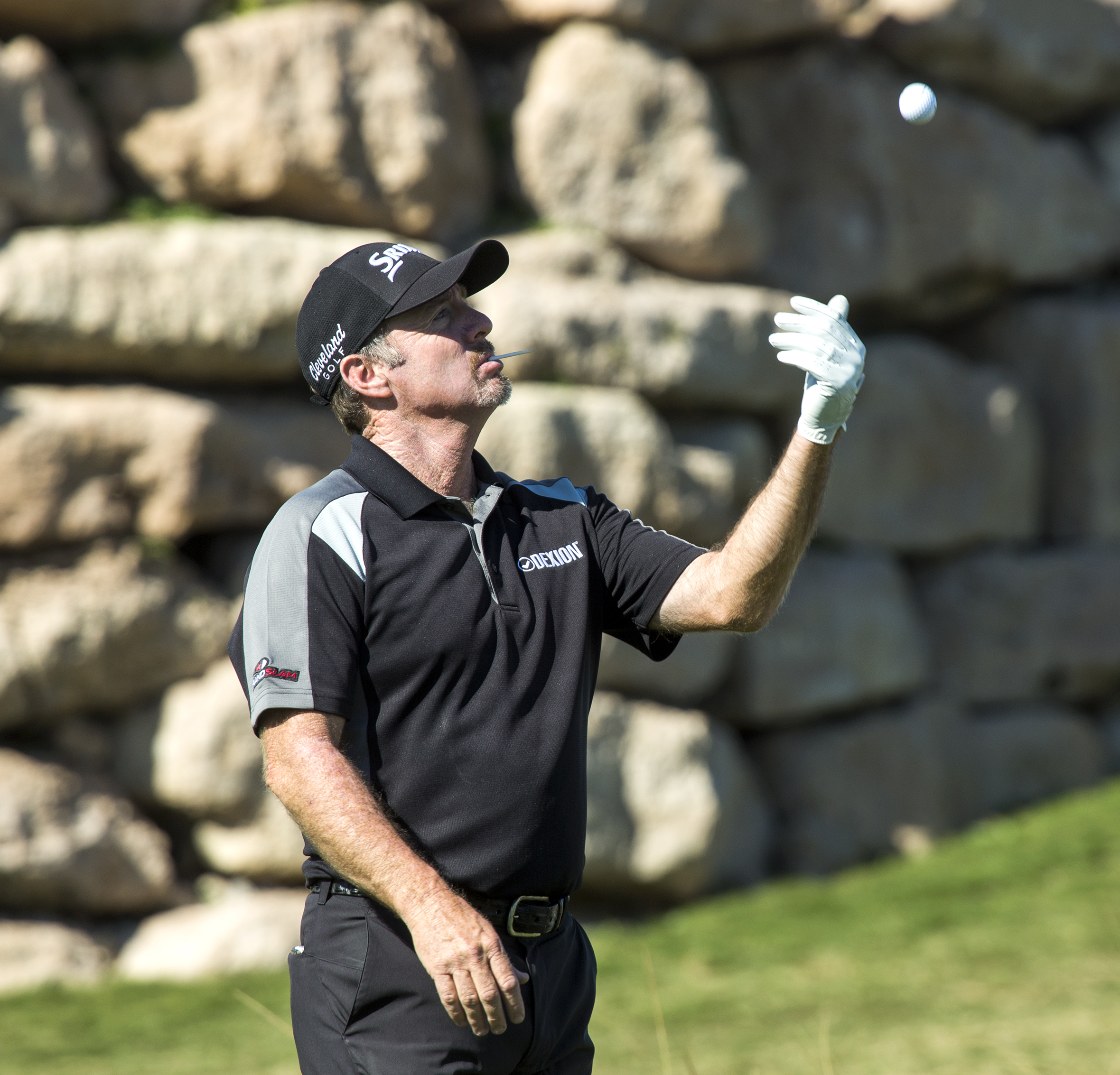 Rod Pampling, from Australia, tosses a golf ball while waiting to tee off on the 17th hole on the opening day of the Shriners Hospitals for Children Open golf tournament in Las Vegas, Thursday, Nov. 3, 2016. (Jeff Scheid/Las Vegas Review-Journal via AP)