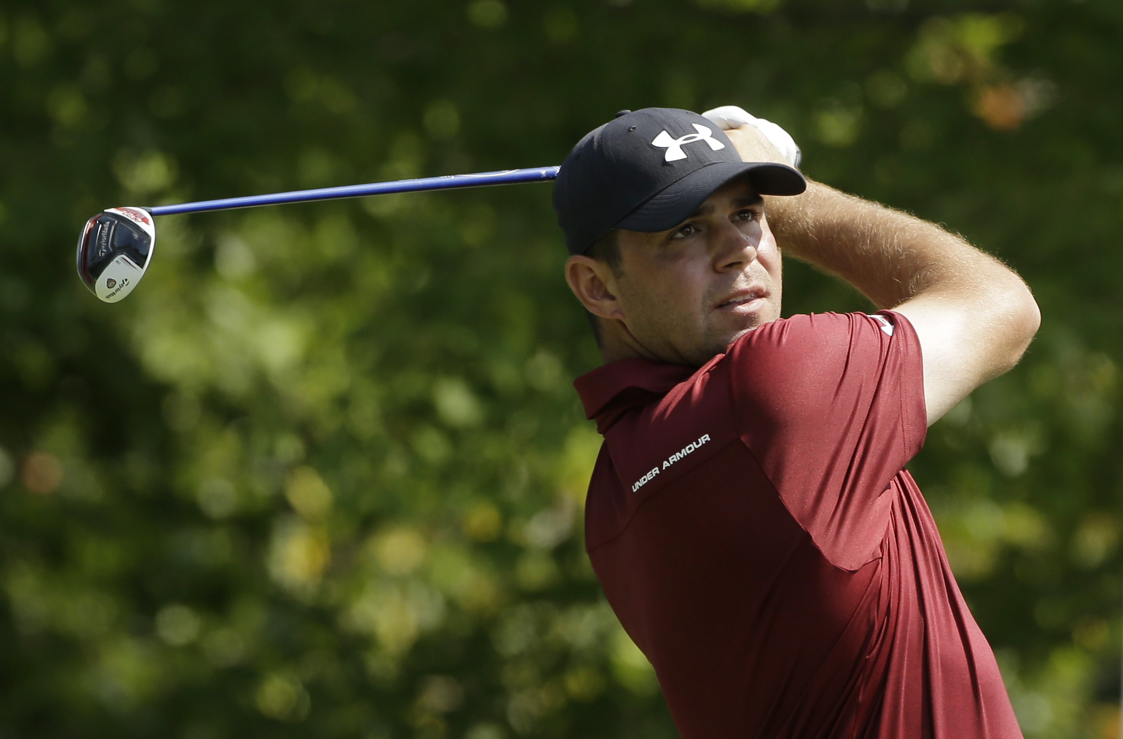 Gary Woodland watches his tee shot on the fourth hole during the third round of the Deutsche Bank Championship golf tournament Sunday, Sept. 4, 2016, in Norton, Mass. (AP Photo/Steven Senne)
