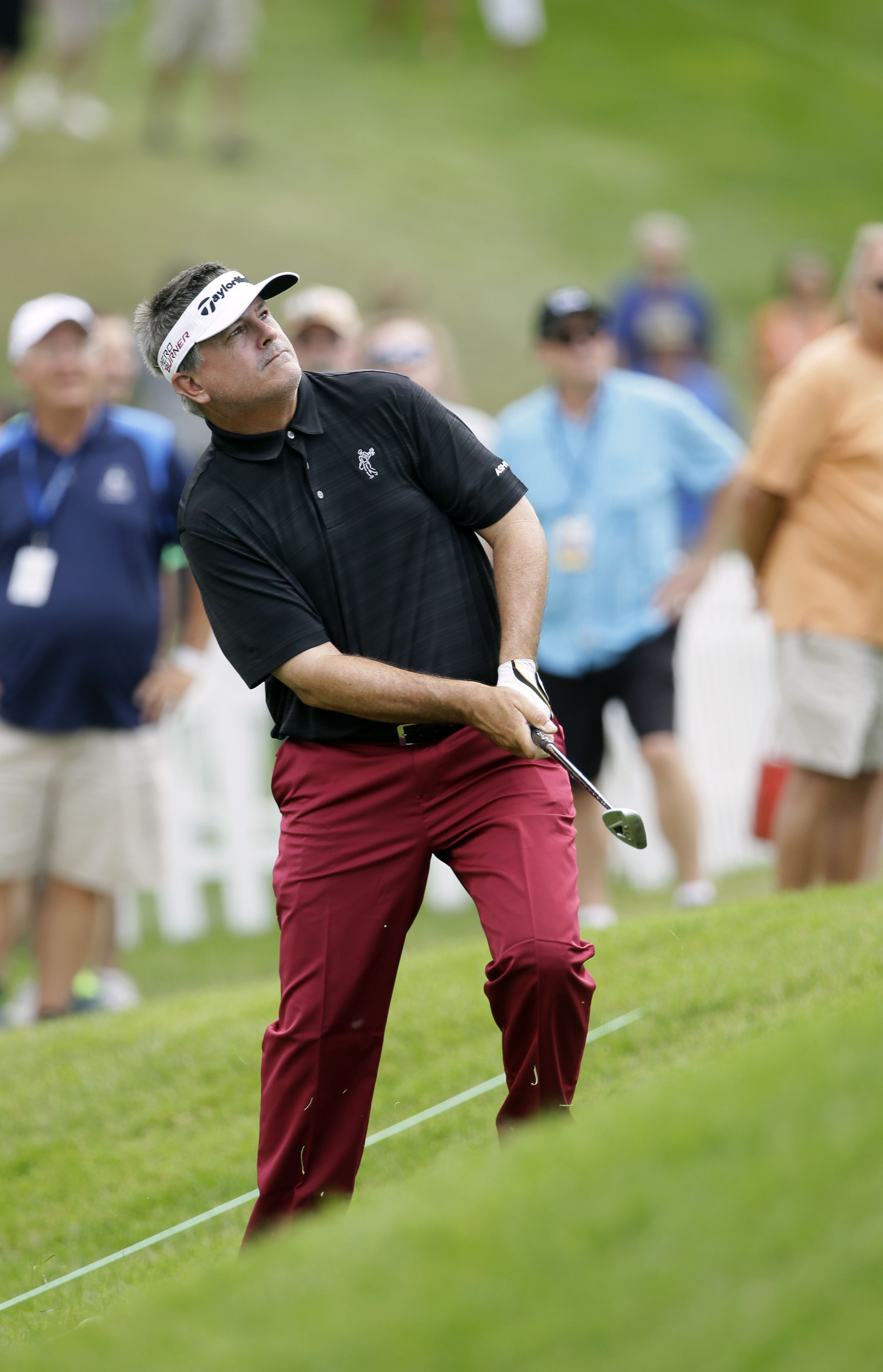 Paul Goydos chips to the first green during the final round of the Champions Tour's Principal Charity Classic golf tournament, Sunday, June 7, 2015, in Des Moines, Iowa. (AP Photo/Charlie Neibergall)