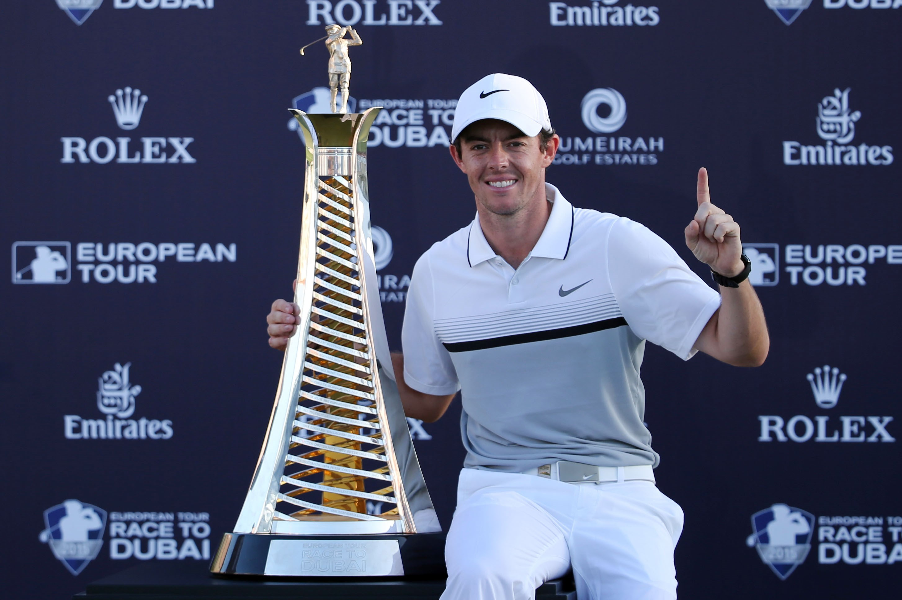 Rory McIlroy of Northern Ireland poses with the Race to Dubai trophy after he won the final round of DP World Tour Championship golf tournament in Dubai, United Arab Emirates, Sunday, Nov. 22, 2015. (AP Photo/Kamran Jebreili)