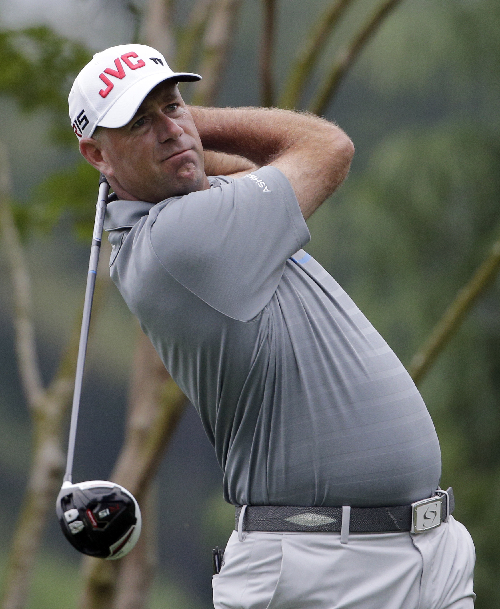Stewart Cink watches his tee shot on the 11th hole during the second round of the Wells Fargo Championship golf tournament at Quail Hollow Club in Charlotte, N.C., Friday, May 15, 2015. (AP Photo/Chuck Burton)