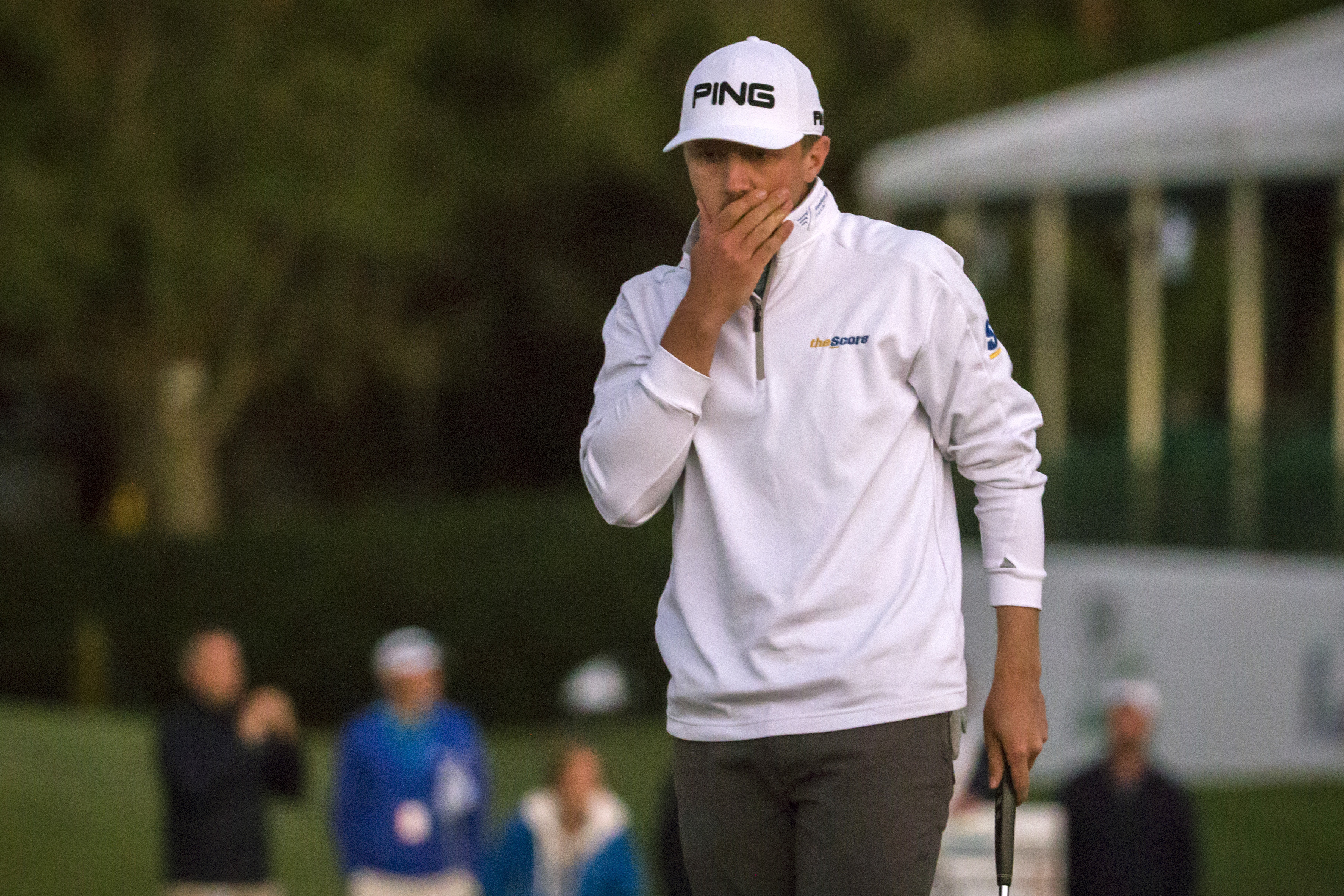 Mackenzie Hughes, of Canada, reacts to a missed birdie putt on the 18th green during second playoff of the final round at the RSM Classic golf tournament, Sunday, Nov. 20, 2016, in St. Simons Island, Ga. The day ended when play was suspended due to darkne